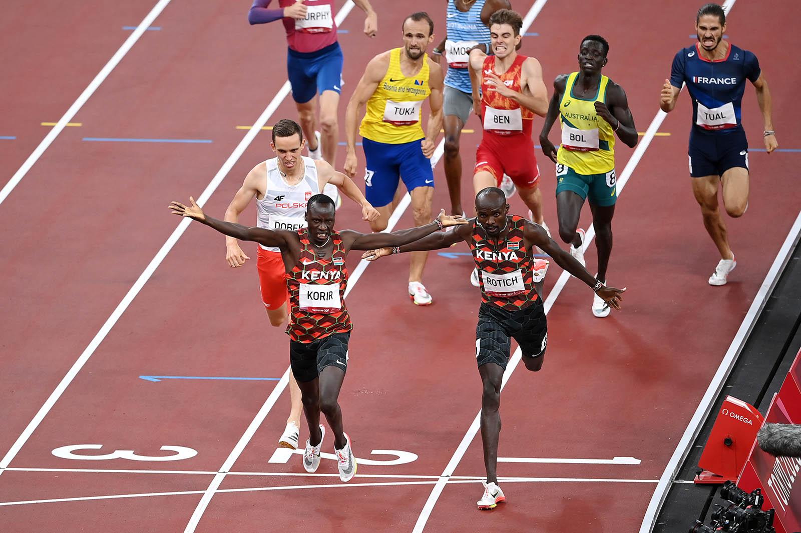 Emmanuel Korir of Kenya crosses the finish line alongside fellow Kenyan Ferguson Cheruiyot Rotichin the men's 800m final on August 4.