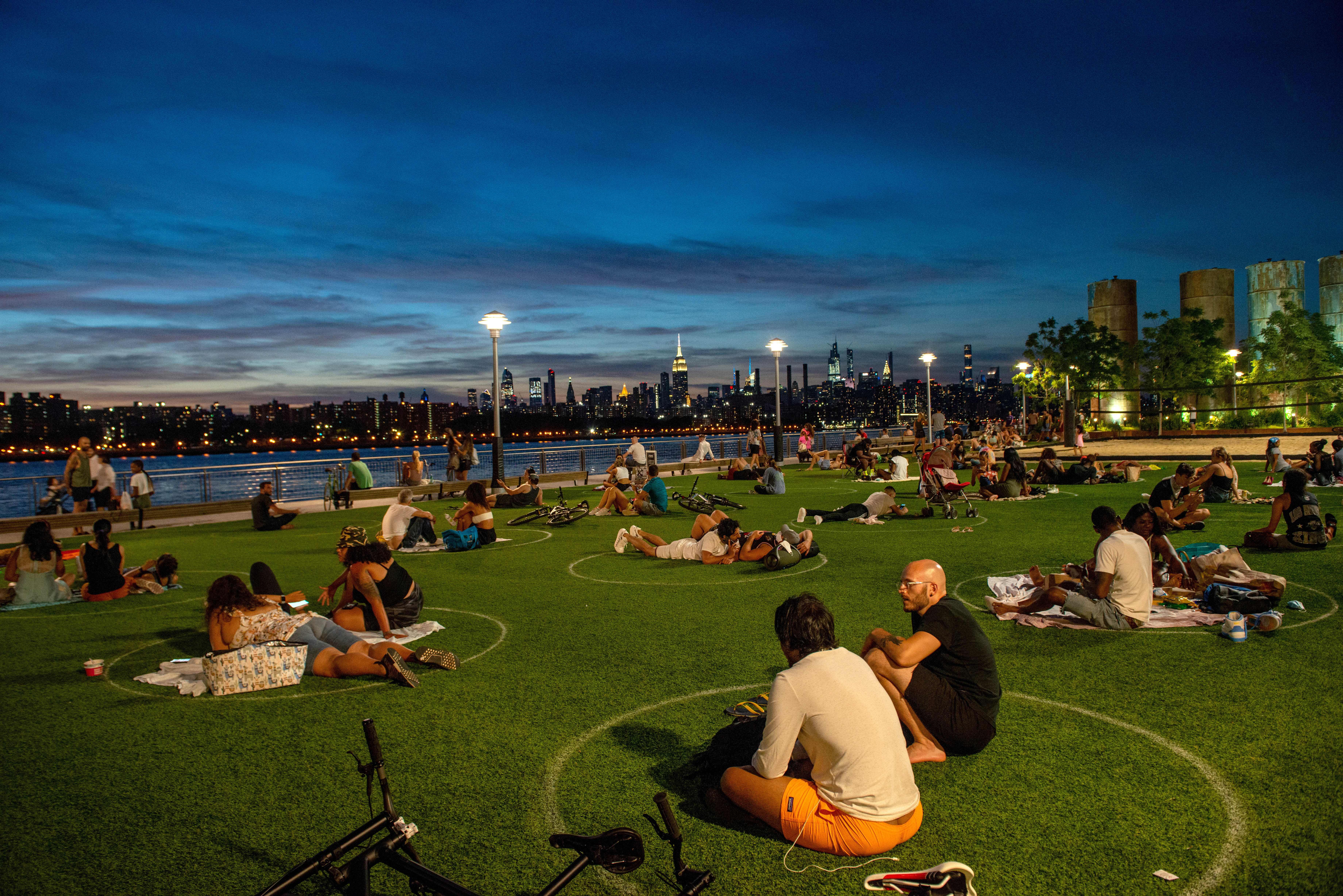 People visit Domino Park in Brookyln, New York, on July 26.