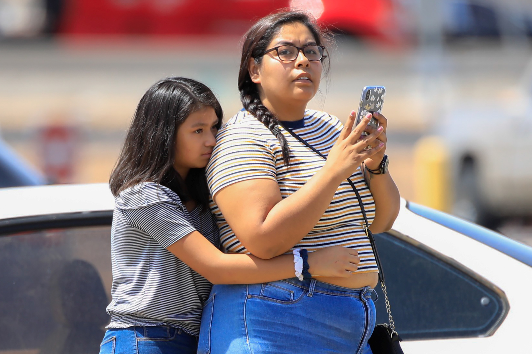 A girl is seen after a mass shooting at a Walmart in El Paso, Texas.