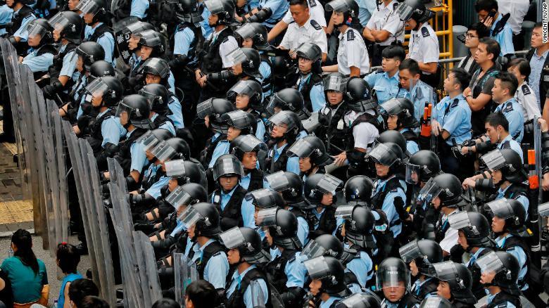 Policemen in anti-riot gear outside Hong Kong's Legislative Council.