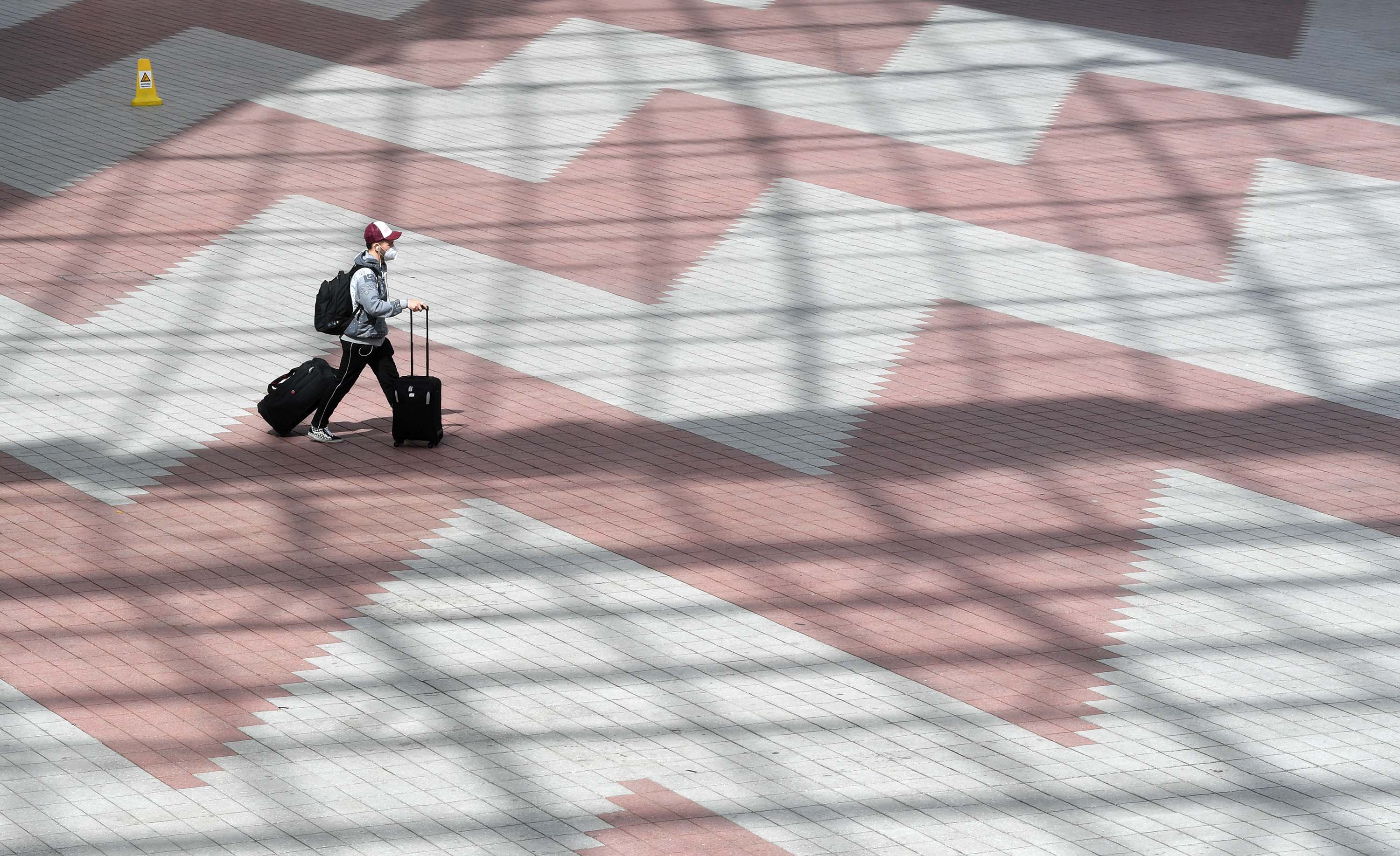 A passenger walks between terminals of the Franz-Josef-Strauss airport in Munich, Germany, on April 8.