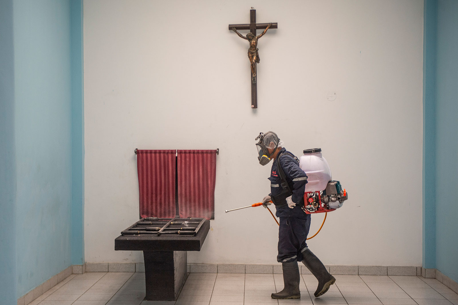 A worker disinfects an area of El Angel crematorium in Lima on May 21.
