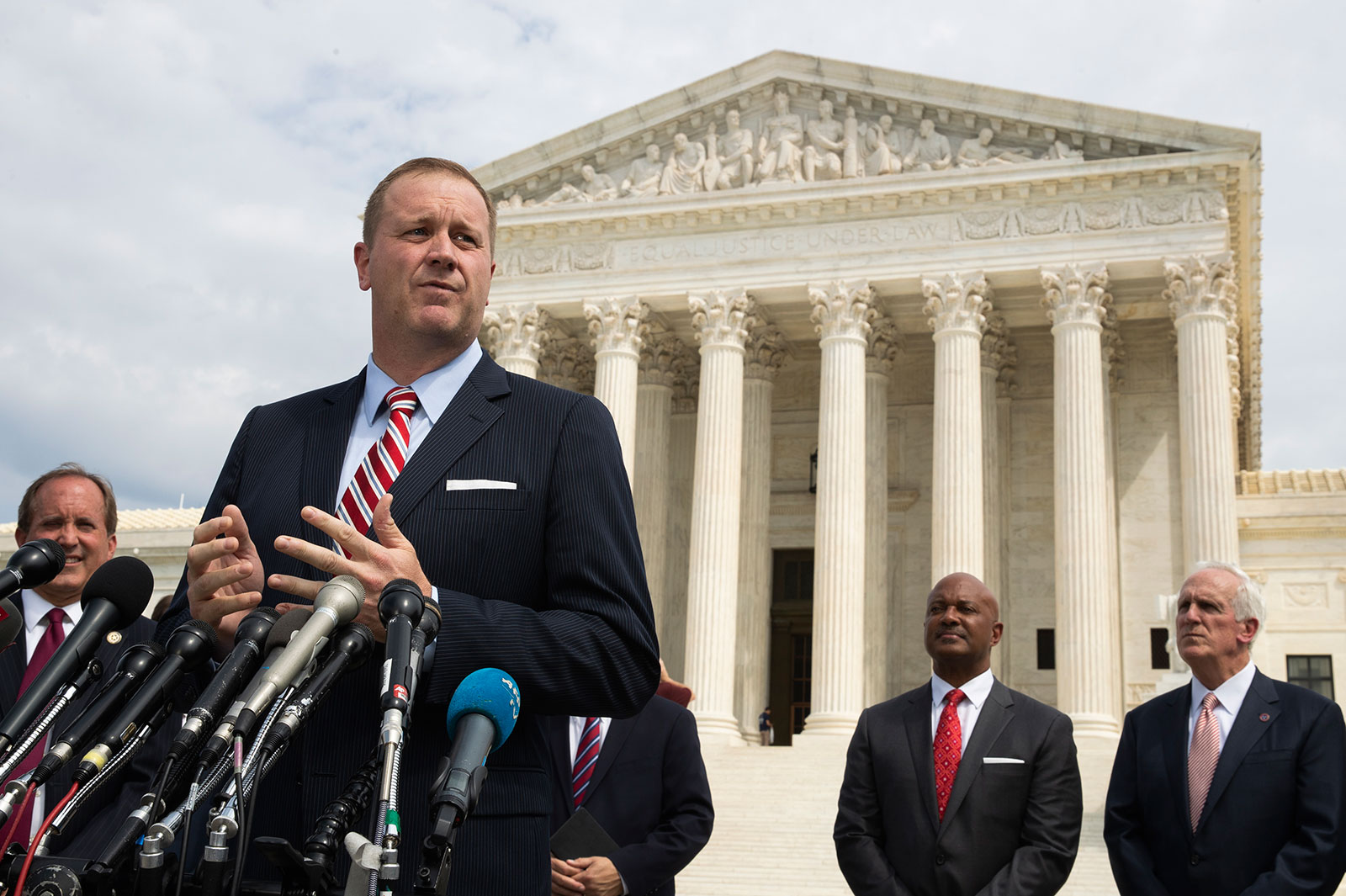 In this September 9, 2019 file photo, Missouri Attorney General Eric Schmitt speaks in front of the US Supreme Court in Washington.