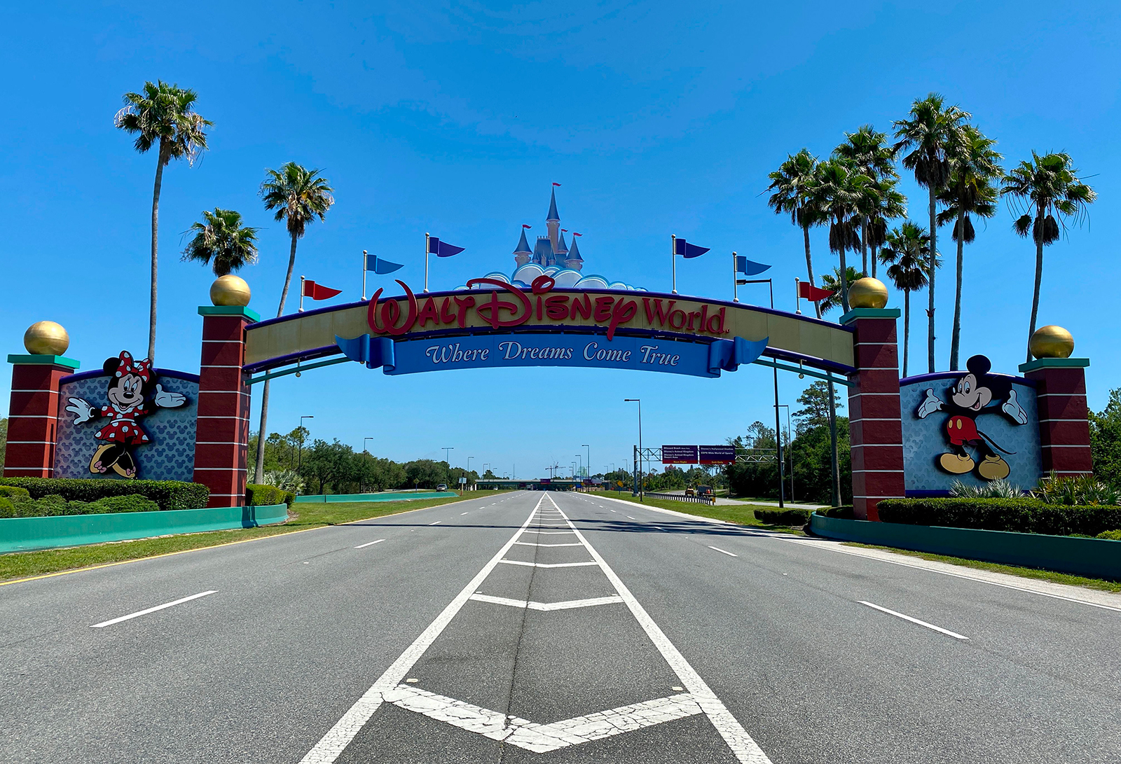 An empty road leads into a deserted Disney resort after it was closed due to the Covid-19 pandemic in Kissimmee, Florida on May 5.