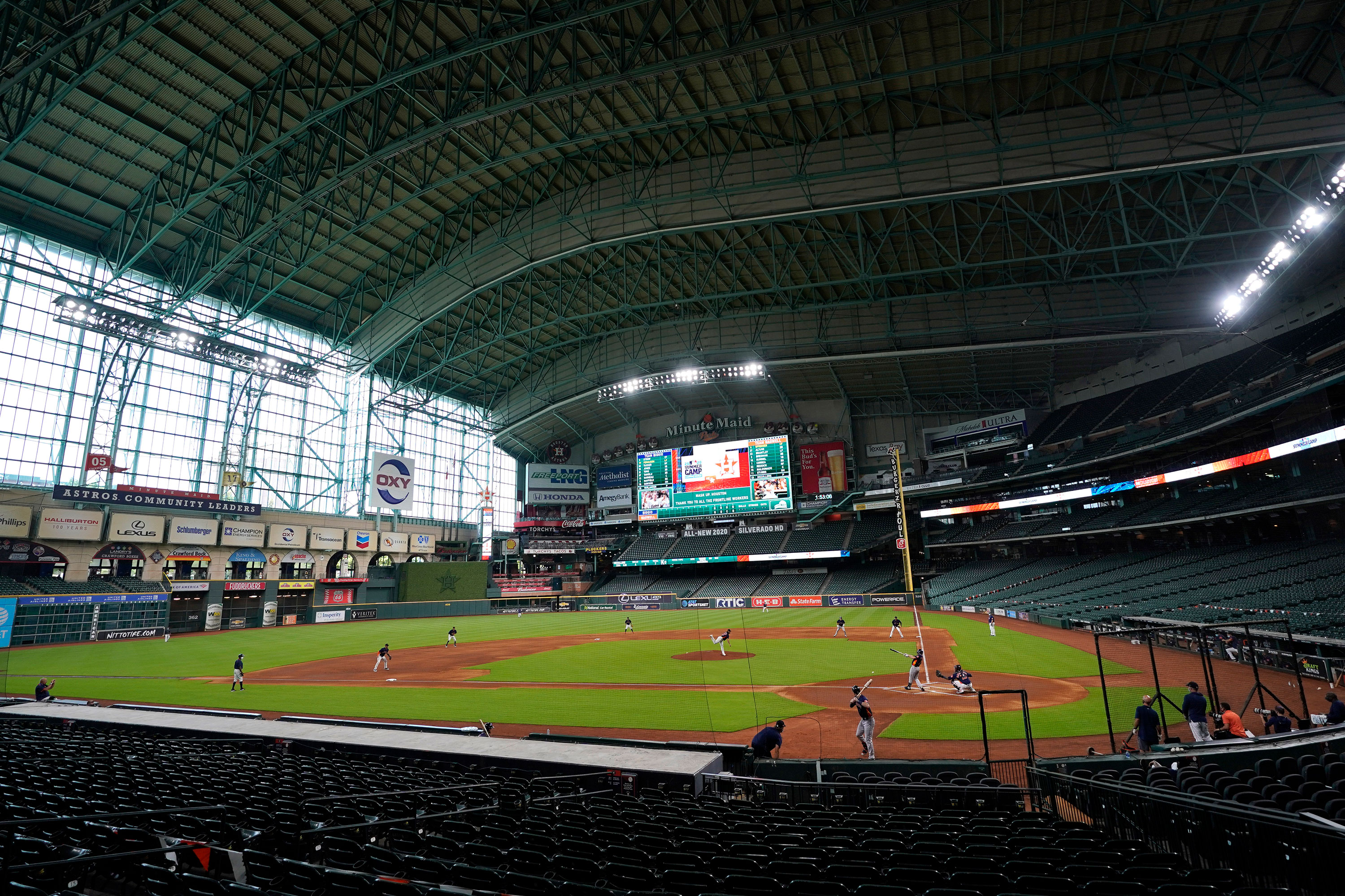 The Houston Astros play a simulated baseball game inside Minute Maid Park in Houston on July 9.
