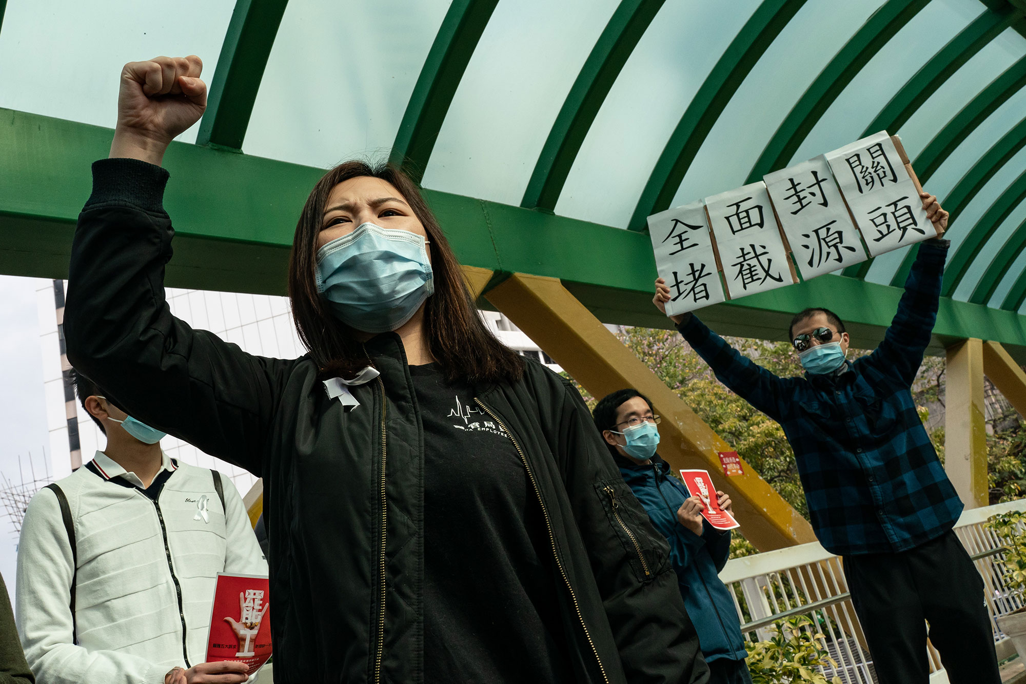 Medical workers hold a strike near Queen Mary Hospital in Hong Kong, on February 3.