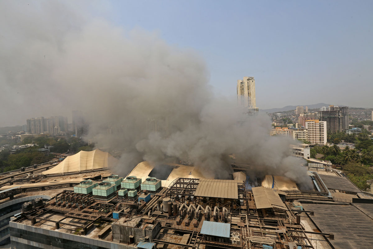 Smoke rises from a fire that broke out at Dreams Mall Sunrise Hospital in Mumbai, India on March 26.