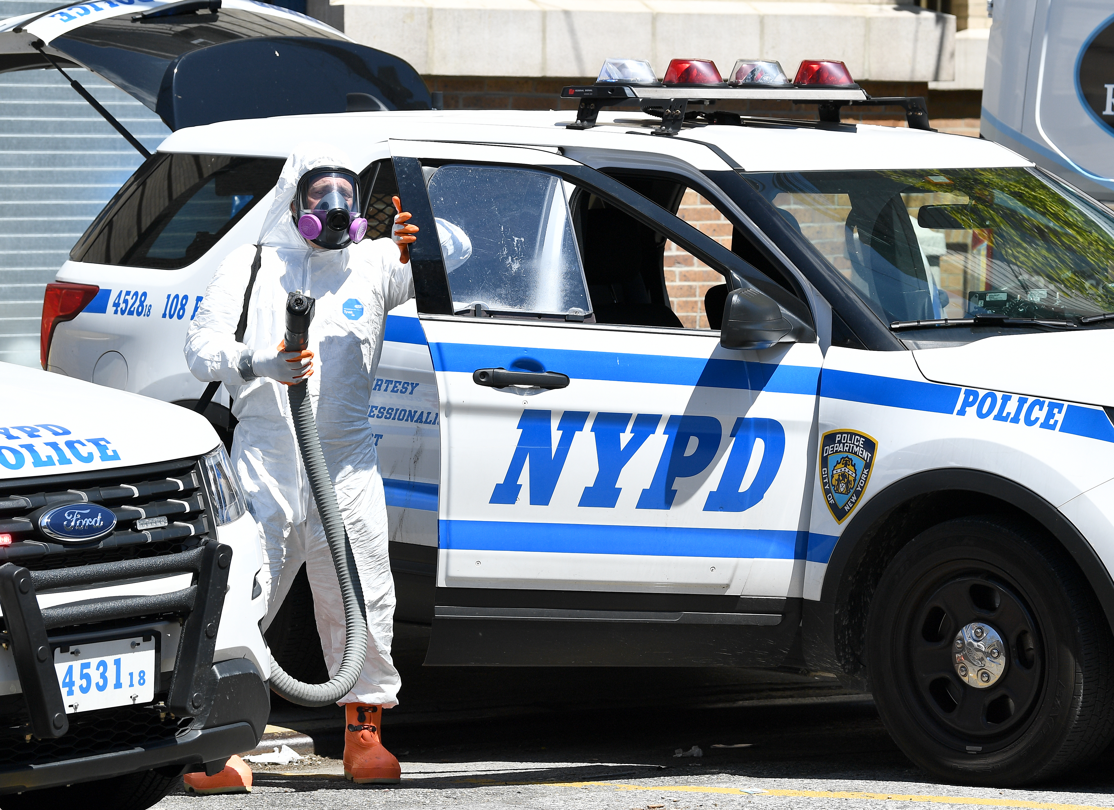 Police ramp up vehicle cleaning procedures in Queens, New York City, on April 28.