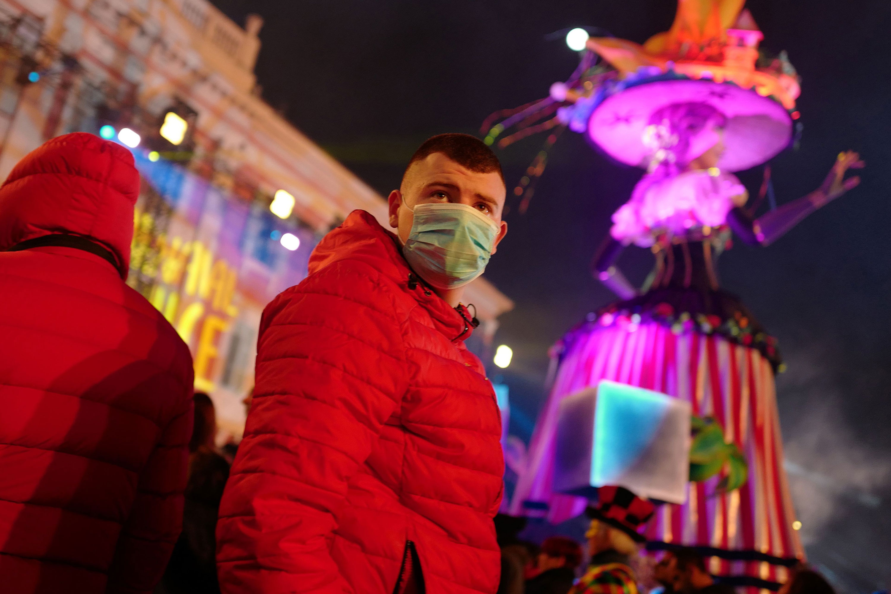 A revellers wears a protective mask at the Nice carnival celebrations on February 25.