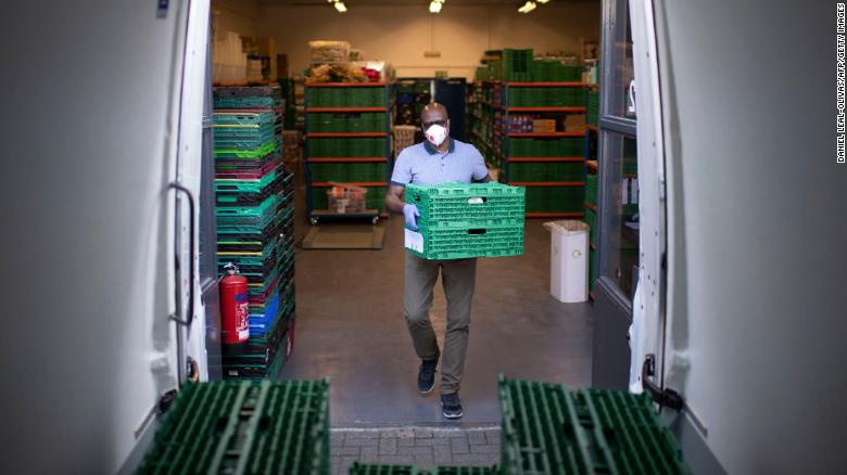 Aerold Bentley, co-founder and chair of the First Love foundation food bank, loads crates packed with goods for distribution to families in Tower Hamlets, east London, on April 24.