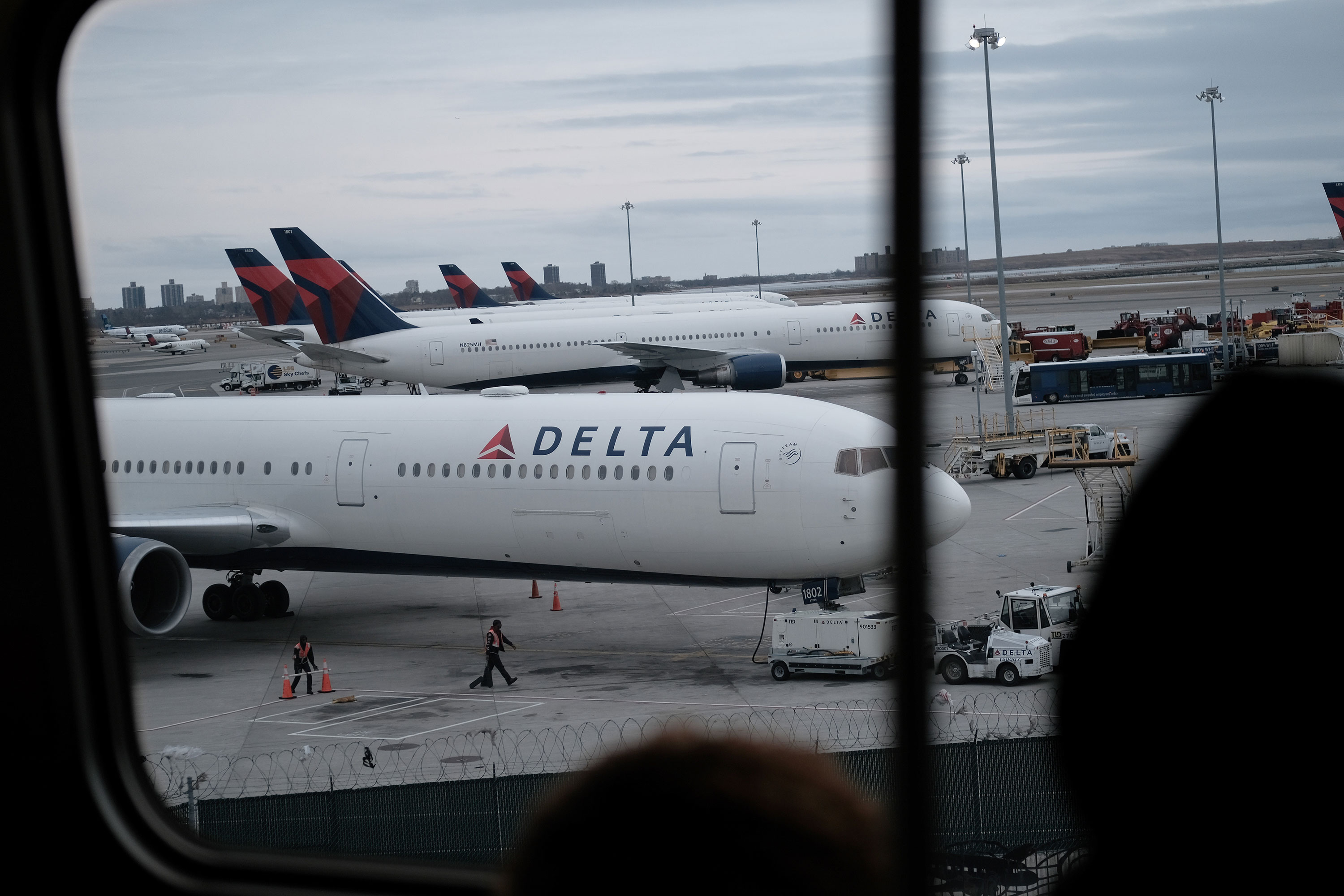 Delta airplanes sit on the tarmac at John F. Kennedy Airport (JFK) on Thursday, January 31, 2020 in New York City.
