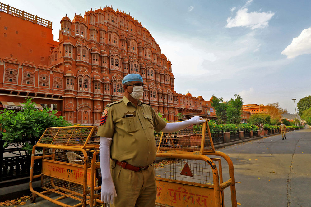 Security personnel near Hawa Mahal, Badi Chopad area during the nationwide lockdown imposed to curb the spread of the coronavirus pandemic in Jaipur, Rajasthan, India, on April 7.