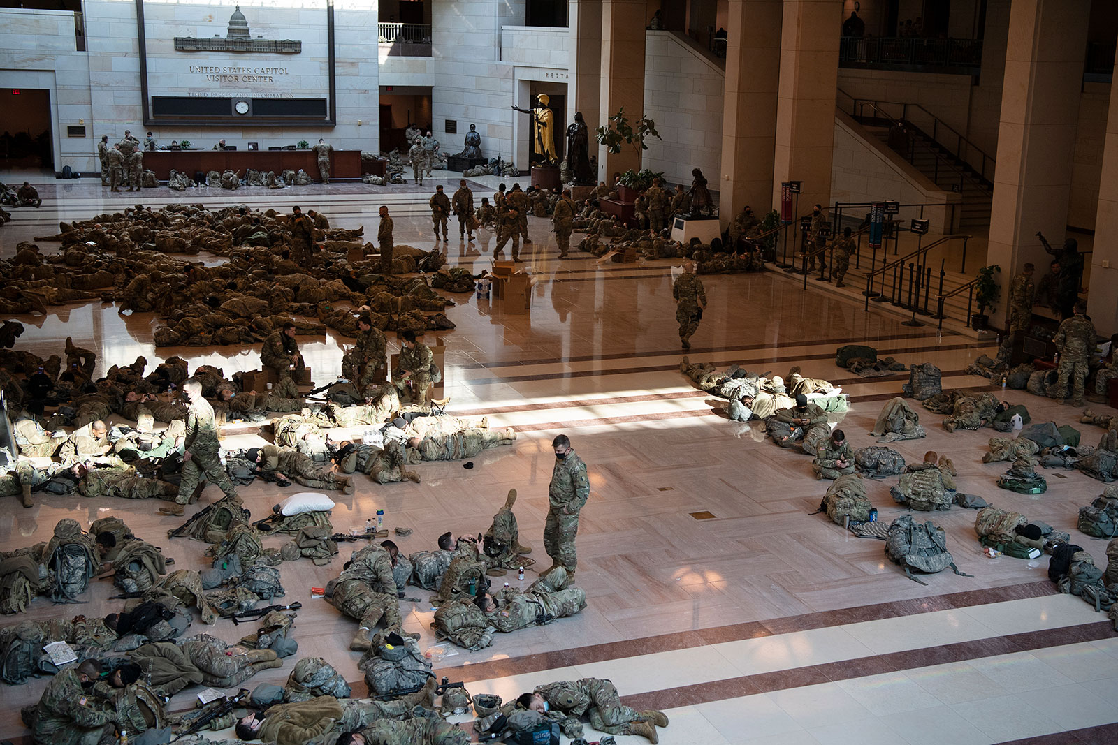 Members of the National Guard rest in the Capitol Visitor Center on January 13.