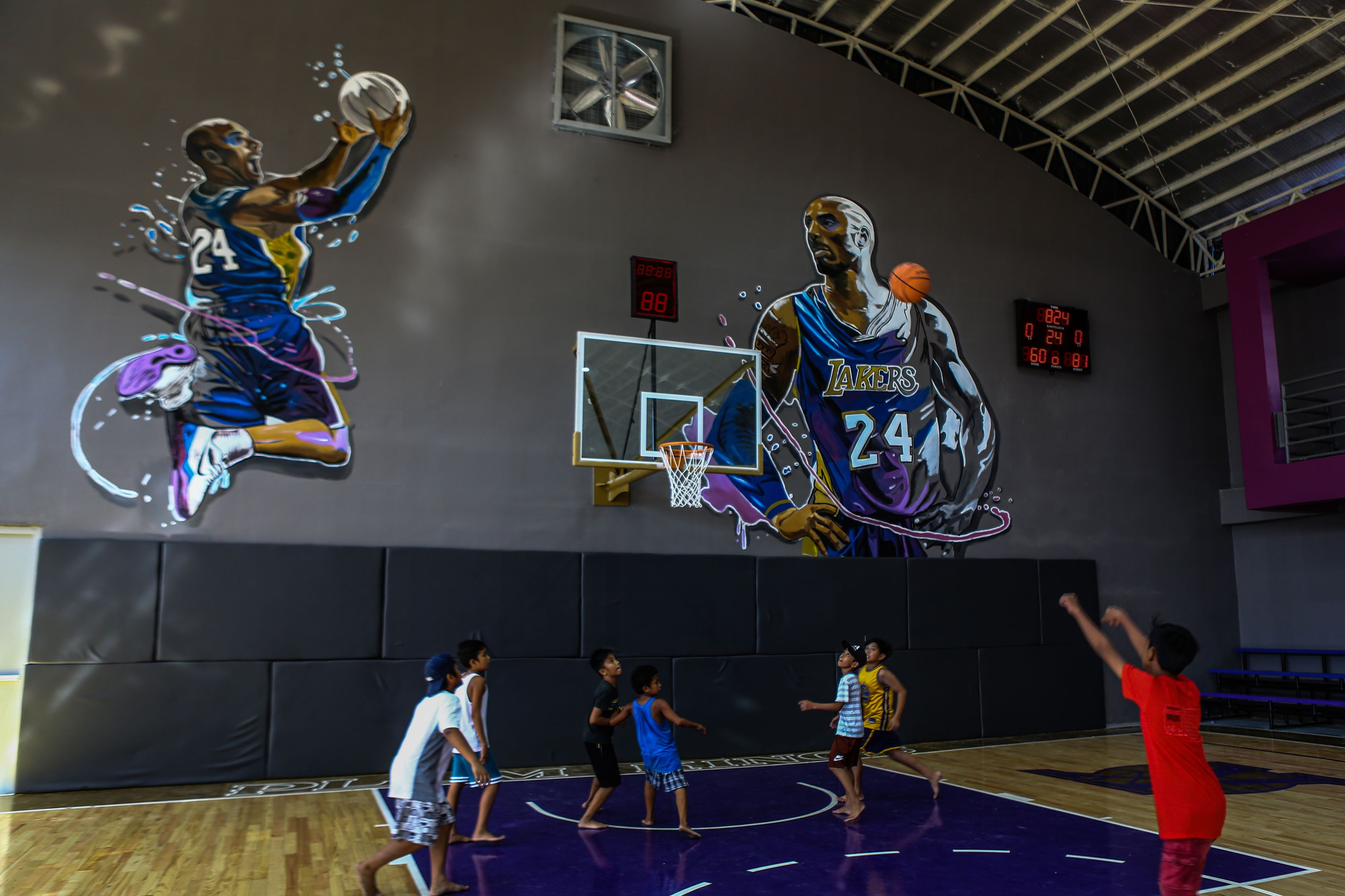 """Children play basketball at the """"House of Kobe"""" gym, built in honor of Bryant."""