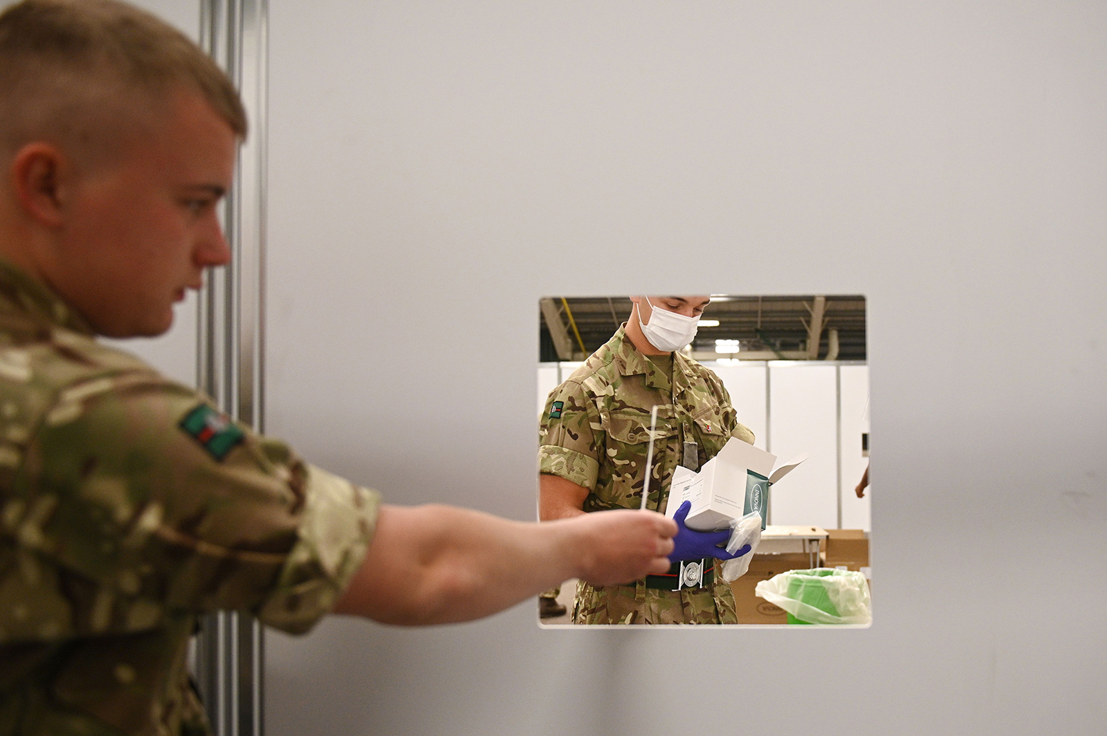 Soldiers practice administering swab tests in advance of it opening to the public at a mass and rapid testing centre for Covid-19 in Liverpool, England, on November 6.