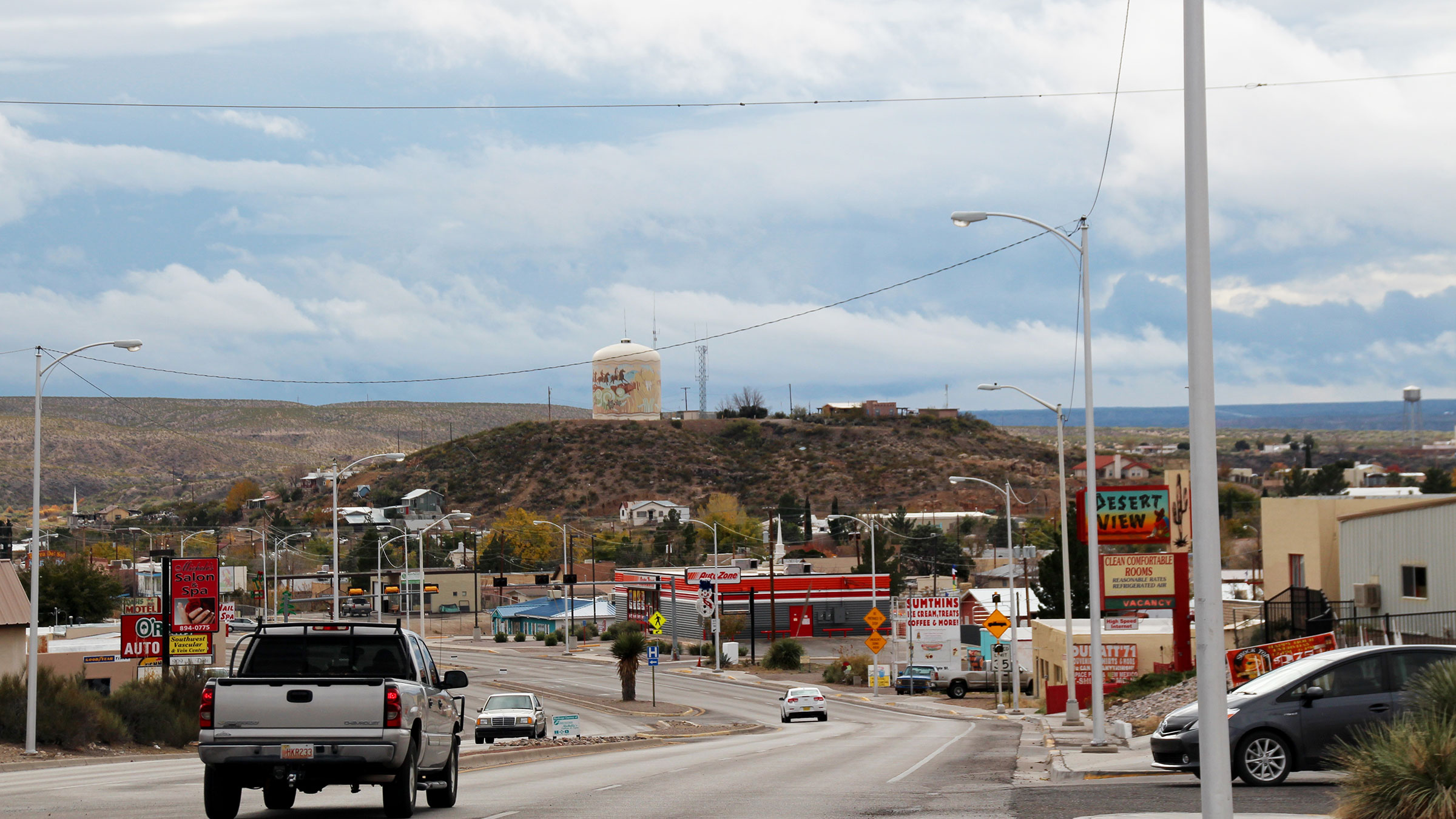 Cars drive through the town of Truth or Consequences, New Mexico.