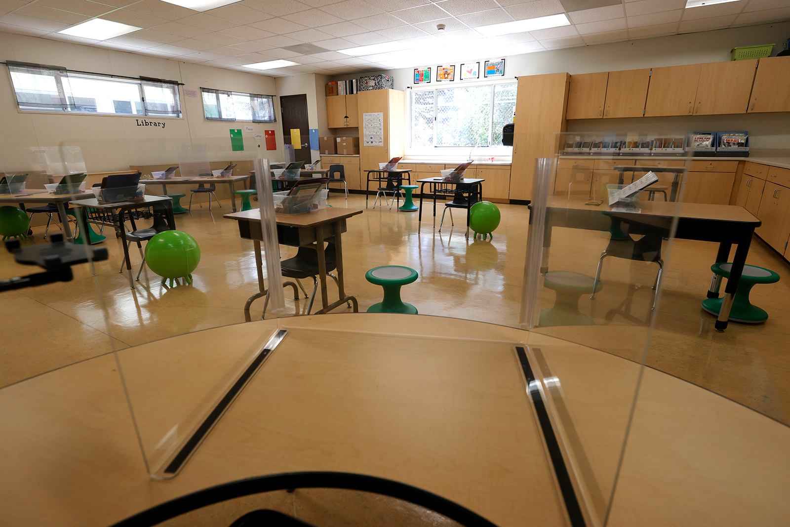 Plexiglass dividers are set up on tables in a first grade classroom at Bryant Elementary School on April 9, 2021 in San Francisco, California.