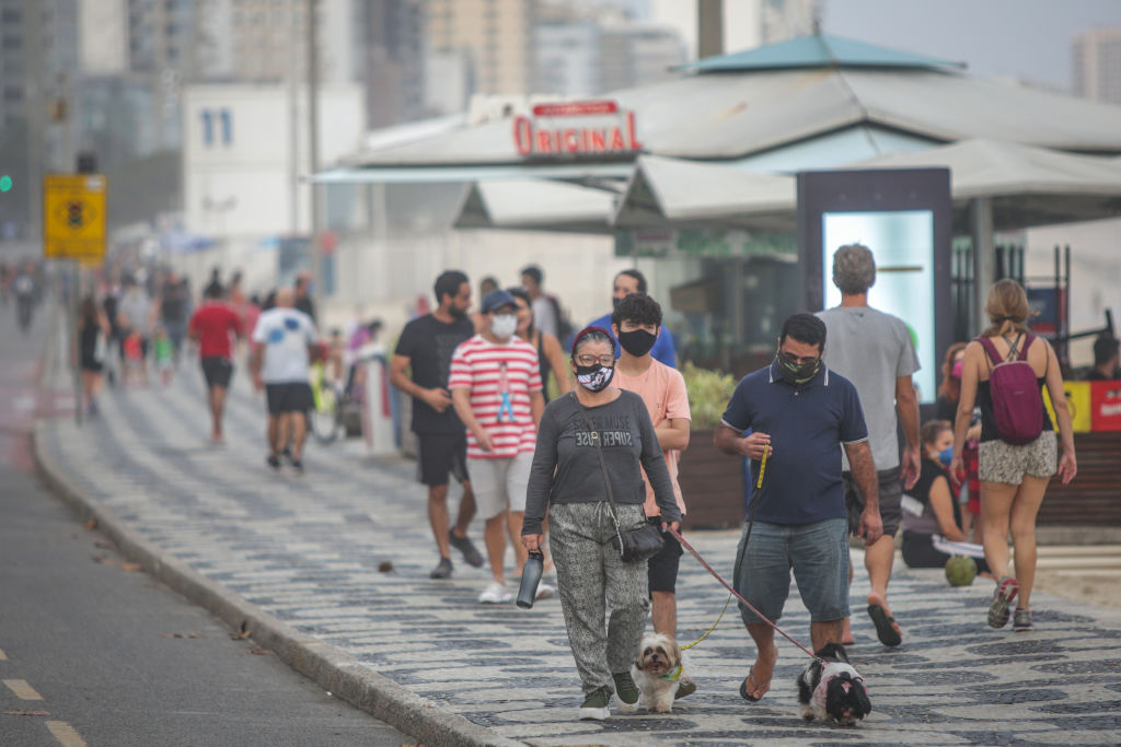 People walk through Rio de Janeiro on Saturday, as the region's lockdown is eased.