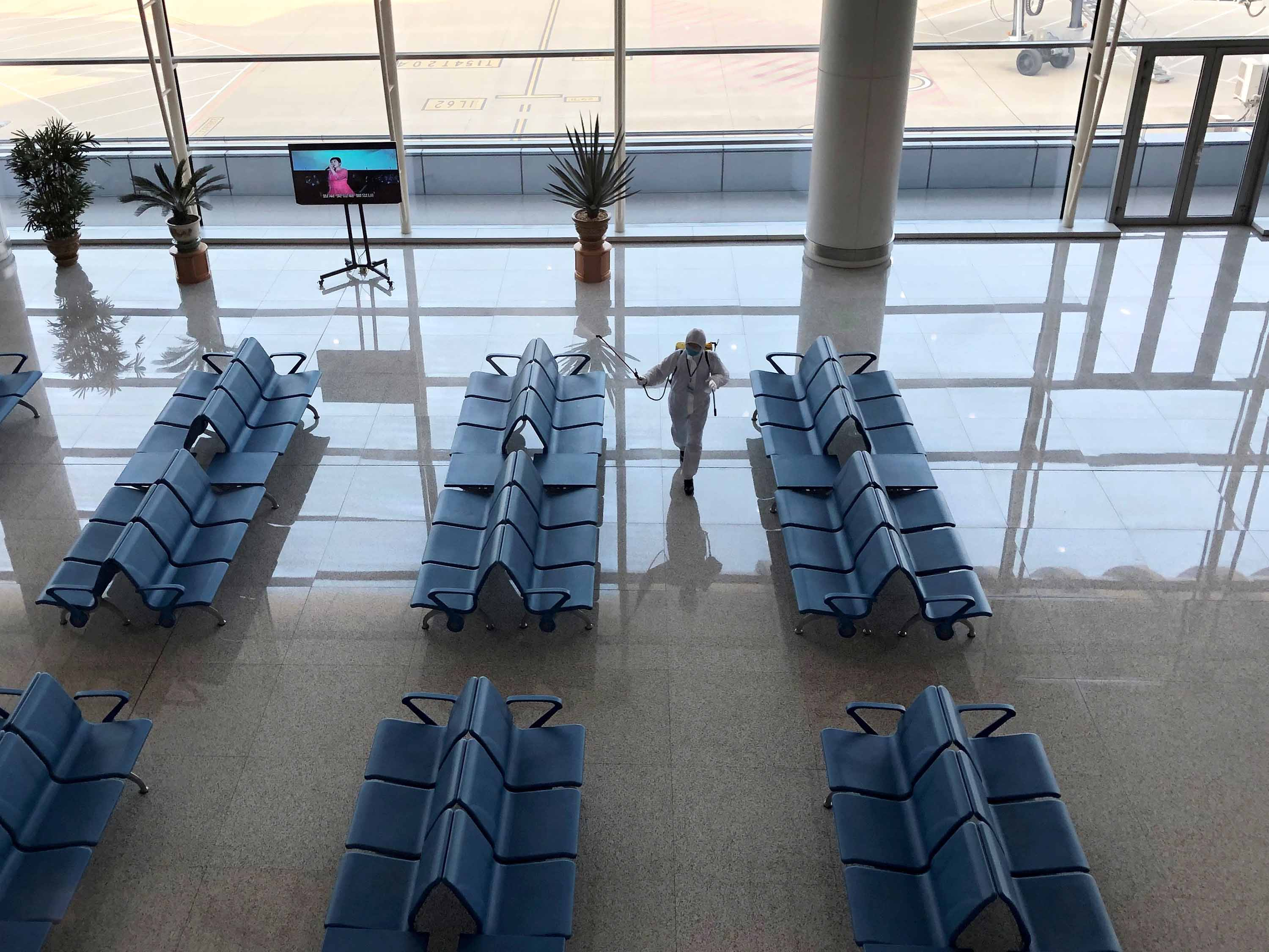 An employee disinfects an area at Pyongyang International Airport in Pyongyang, North Korea, on Monday.