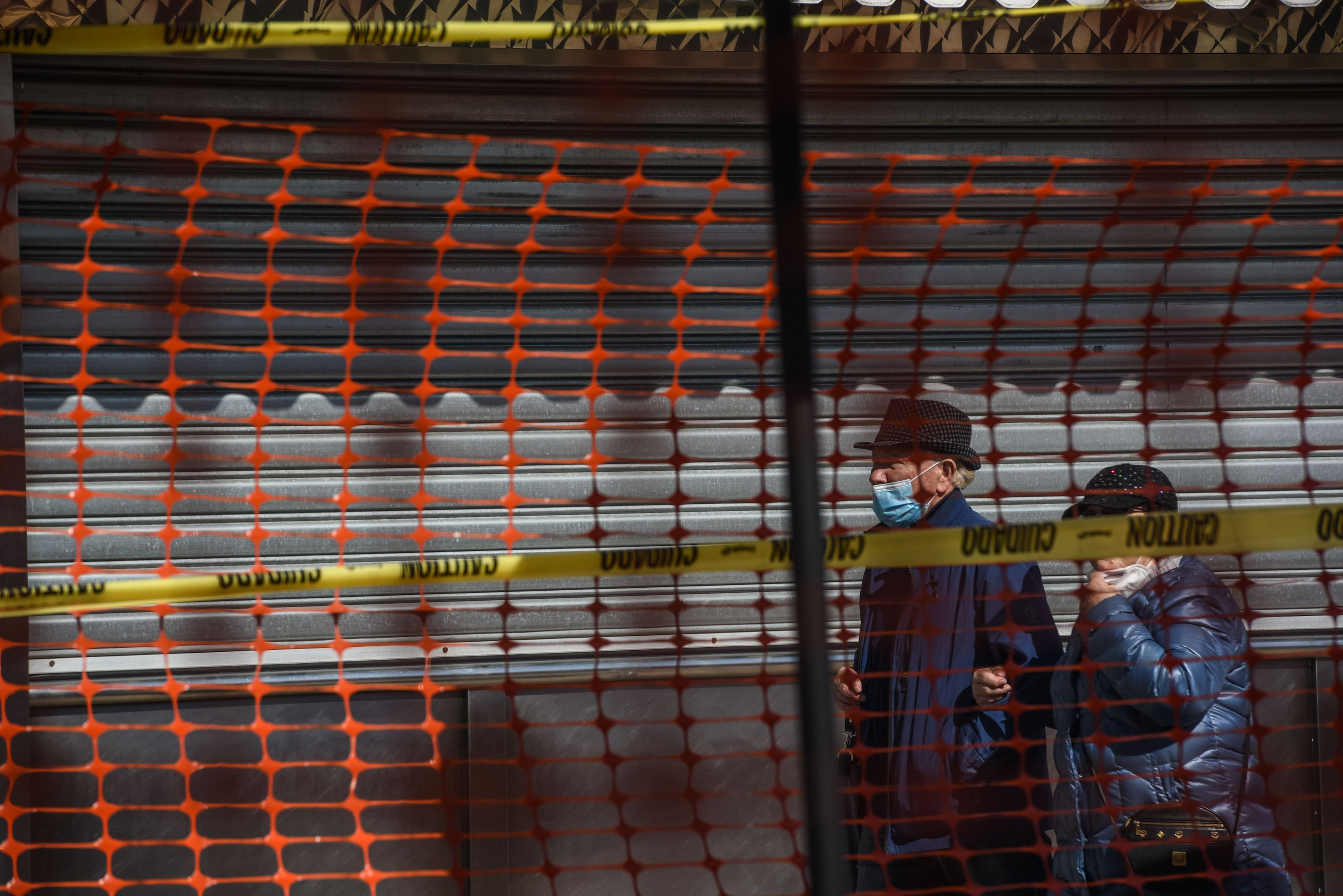 People walk by Nathan's Famous restaurant in the Coney Island neighborhood of Brooklyn, New York, on May 13.