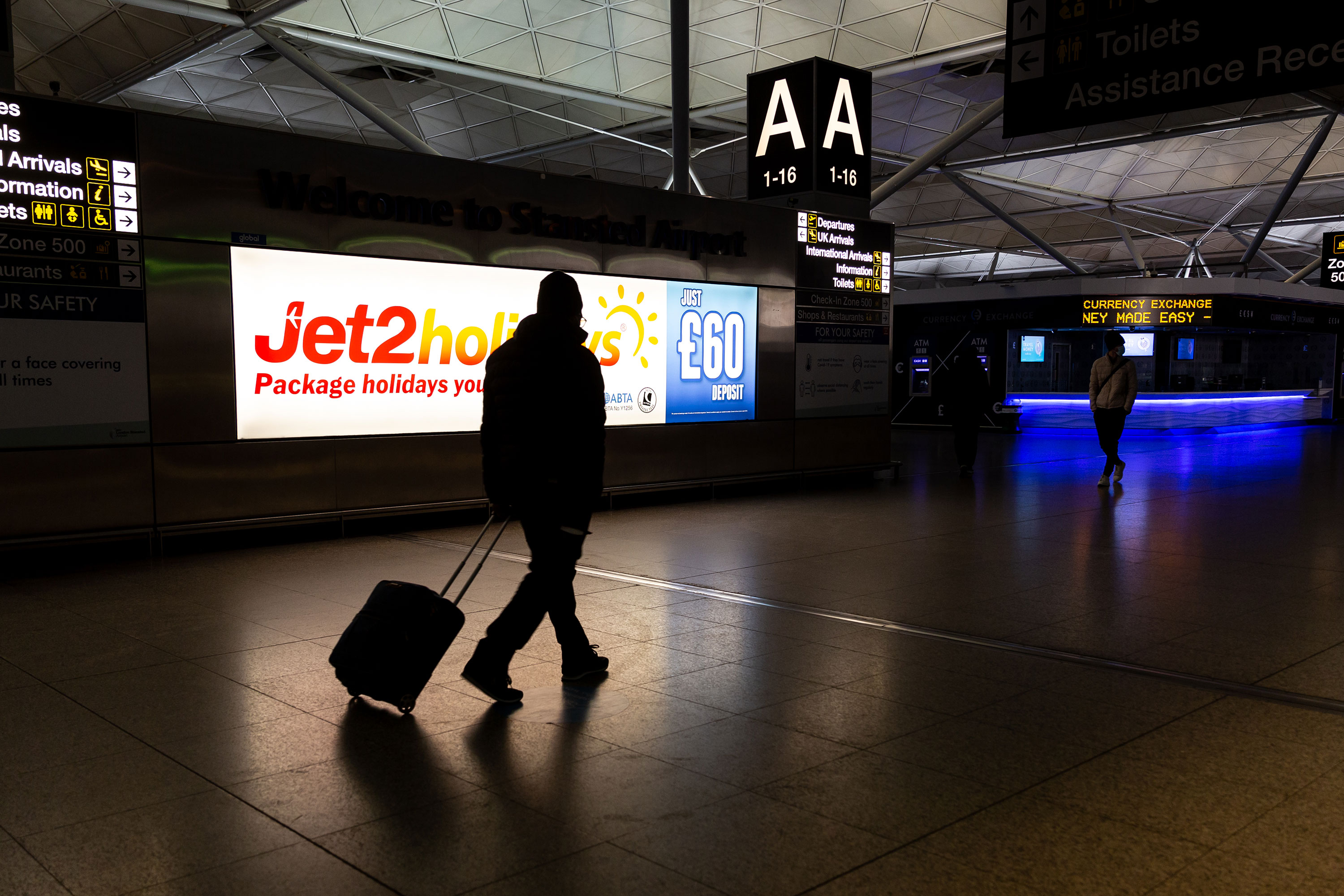 A passenger is seen arriving at London Stansted Airport in London, England, on January 9.