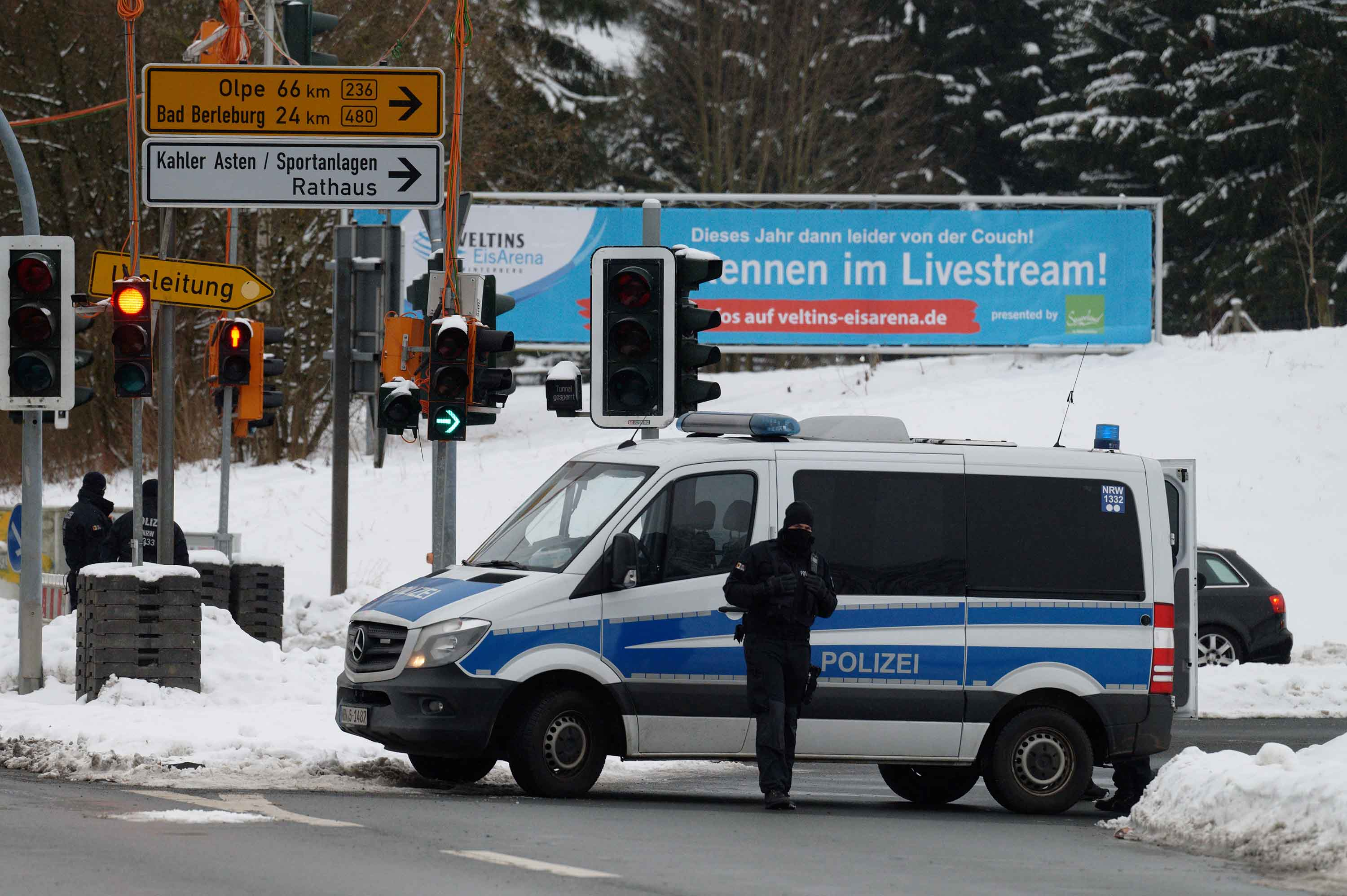 Police officers close the access road to the ski resort in Winterberg, Germany, on January 3.
