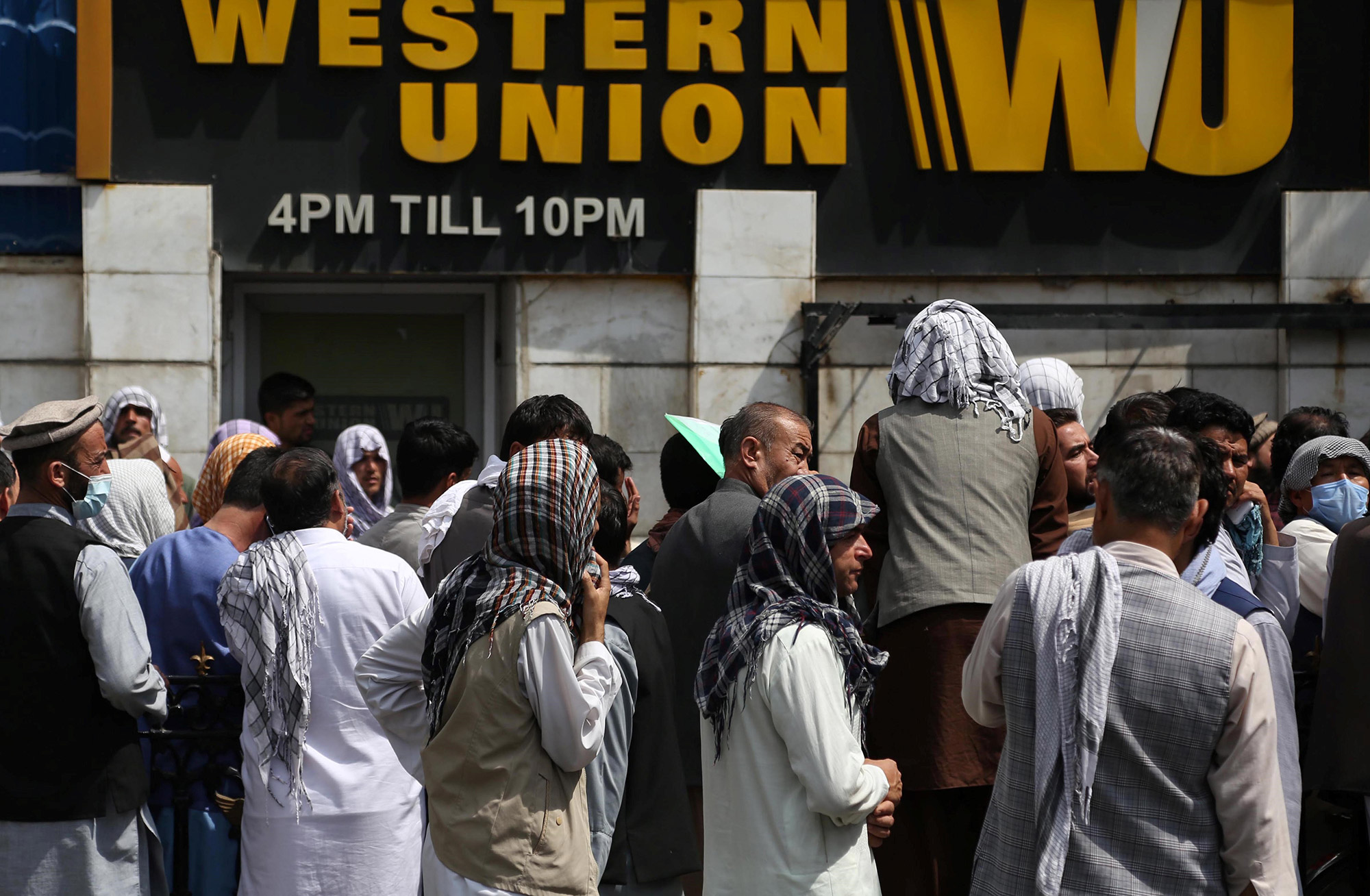 People line up in front of a bank in Kabul, Afghanistan, on August 31.