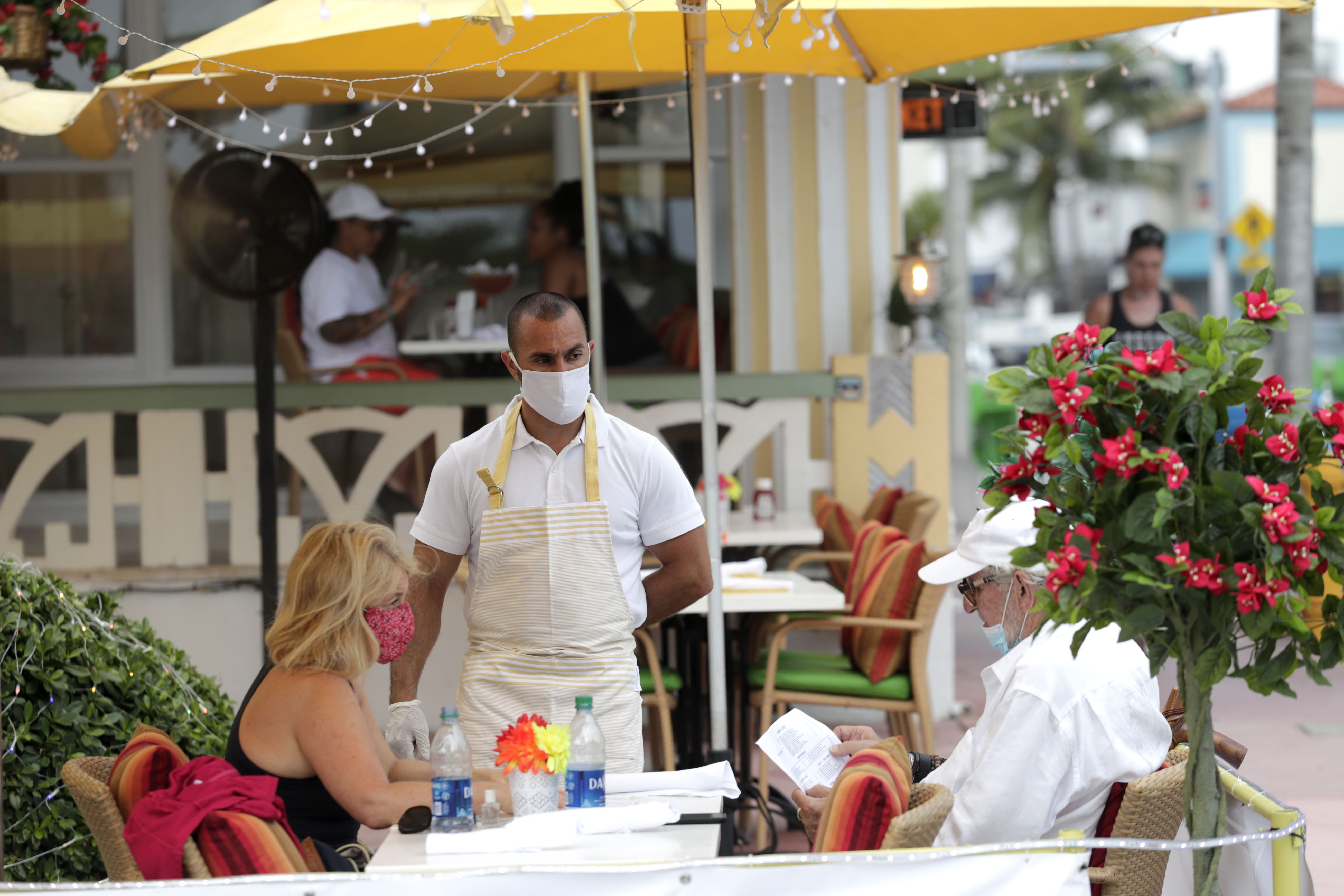 People order at a restaurant in Miami Beach, Florida, on May 27.