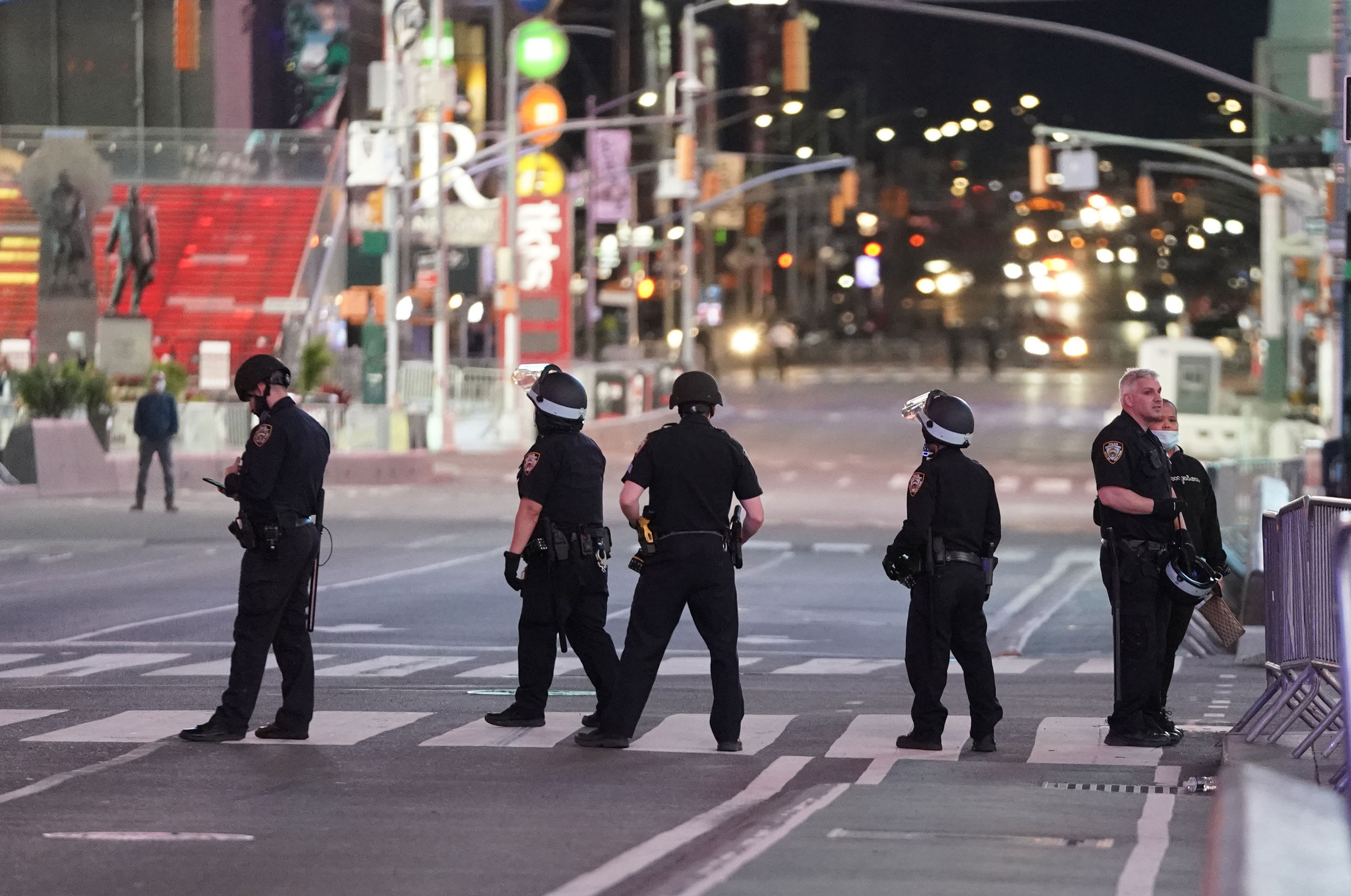 New York police officers patrol the streets on Monday night.
