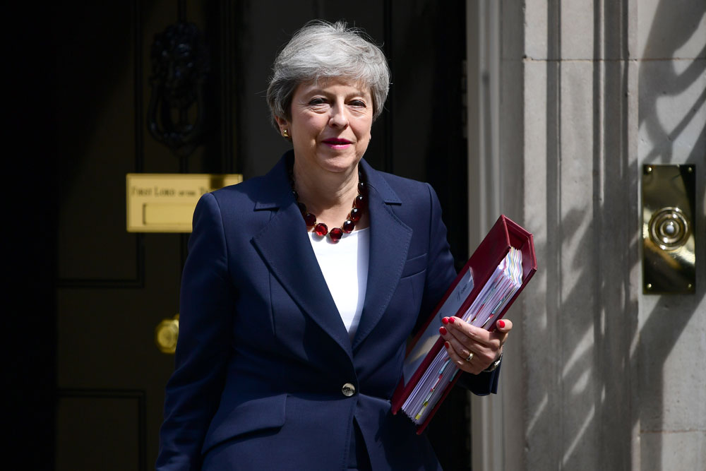 Former UK prime minister Theresa May leaves Downing Street in this July 17, 2019 file photo in London, England.
