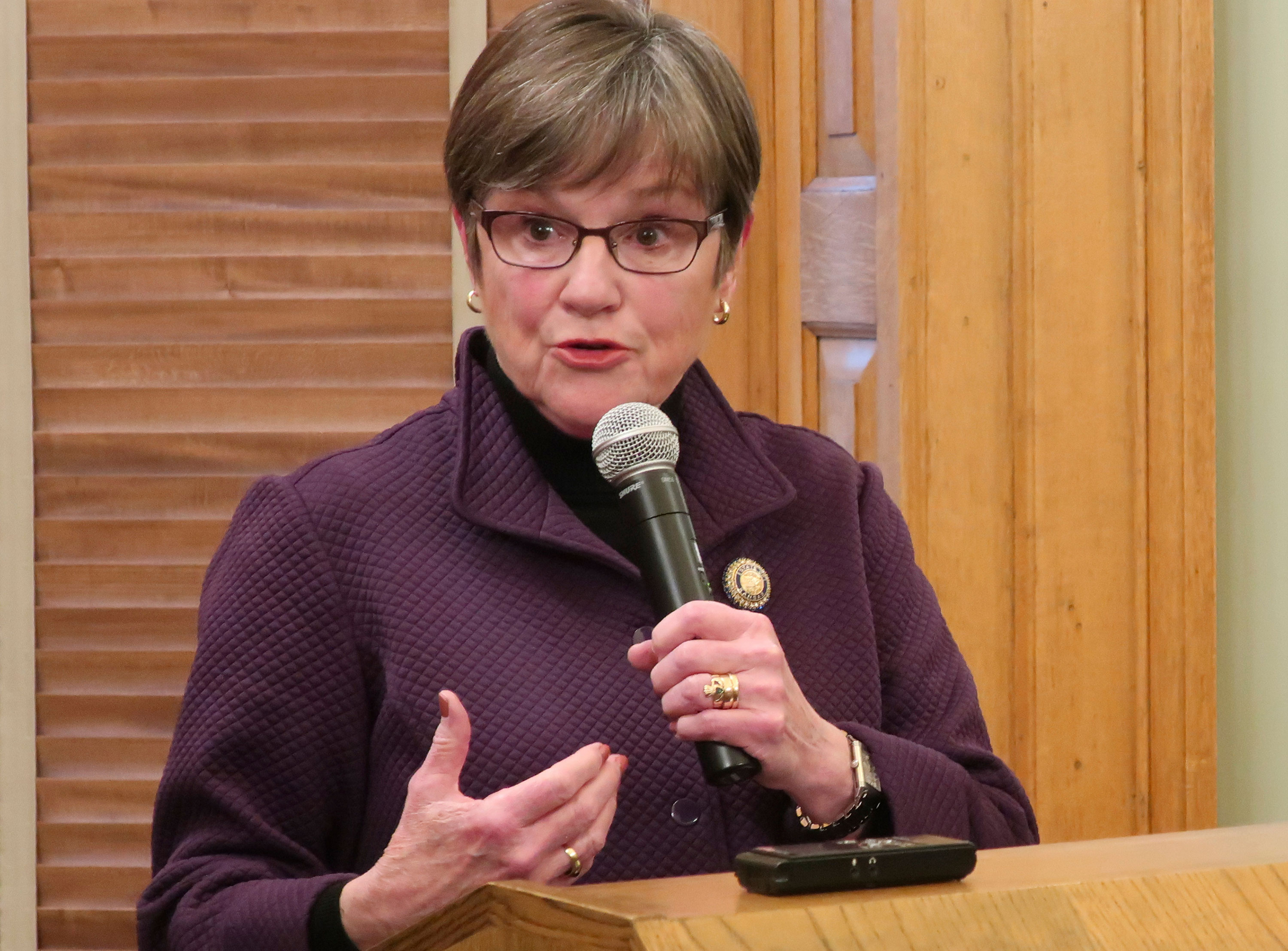 Kansas Gov. Laura Kelly answers questions from reporters in Topeka, Kanas, on March 15.