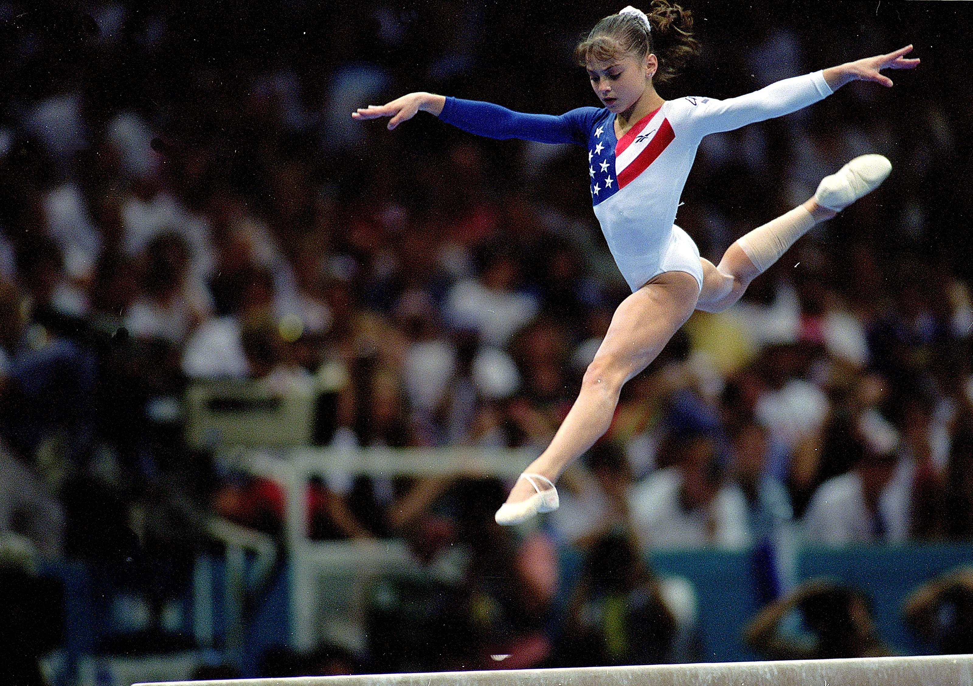 American gymnast Dominique Moceanu competes during the beam event at the1996 Olympic Games in Atlanta.
