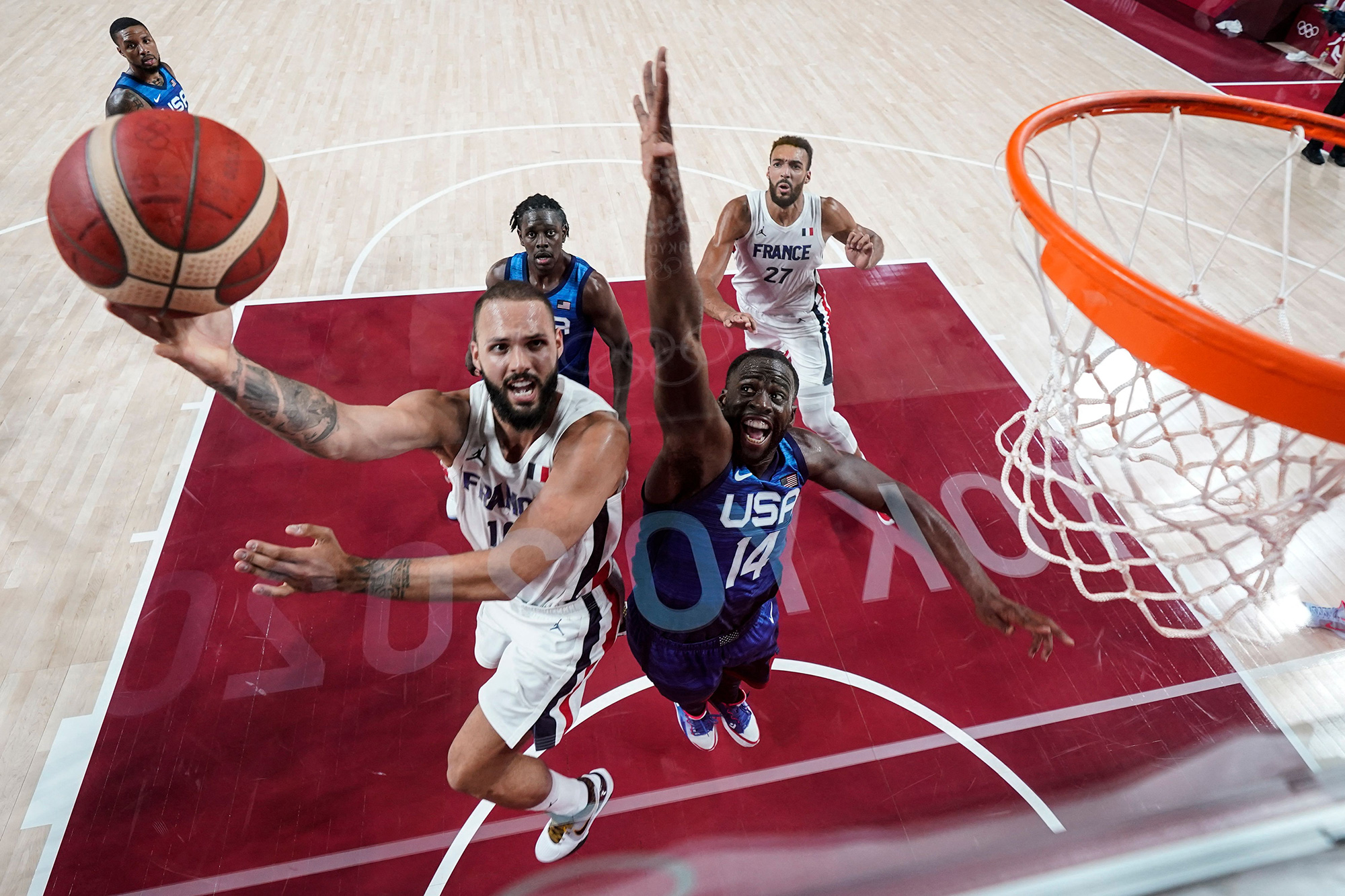 France's Evan Fournier goes for the basket past United States' Draymond Jamal Green during a basketball game on Sunday, July 25.