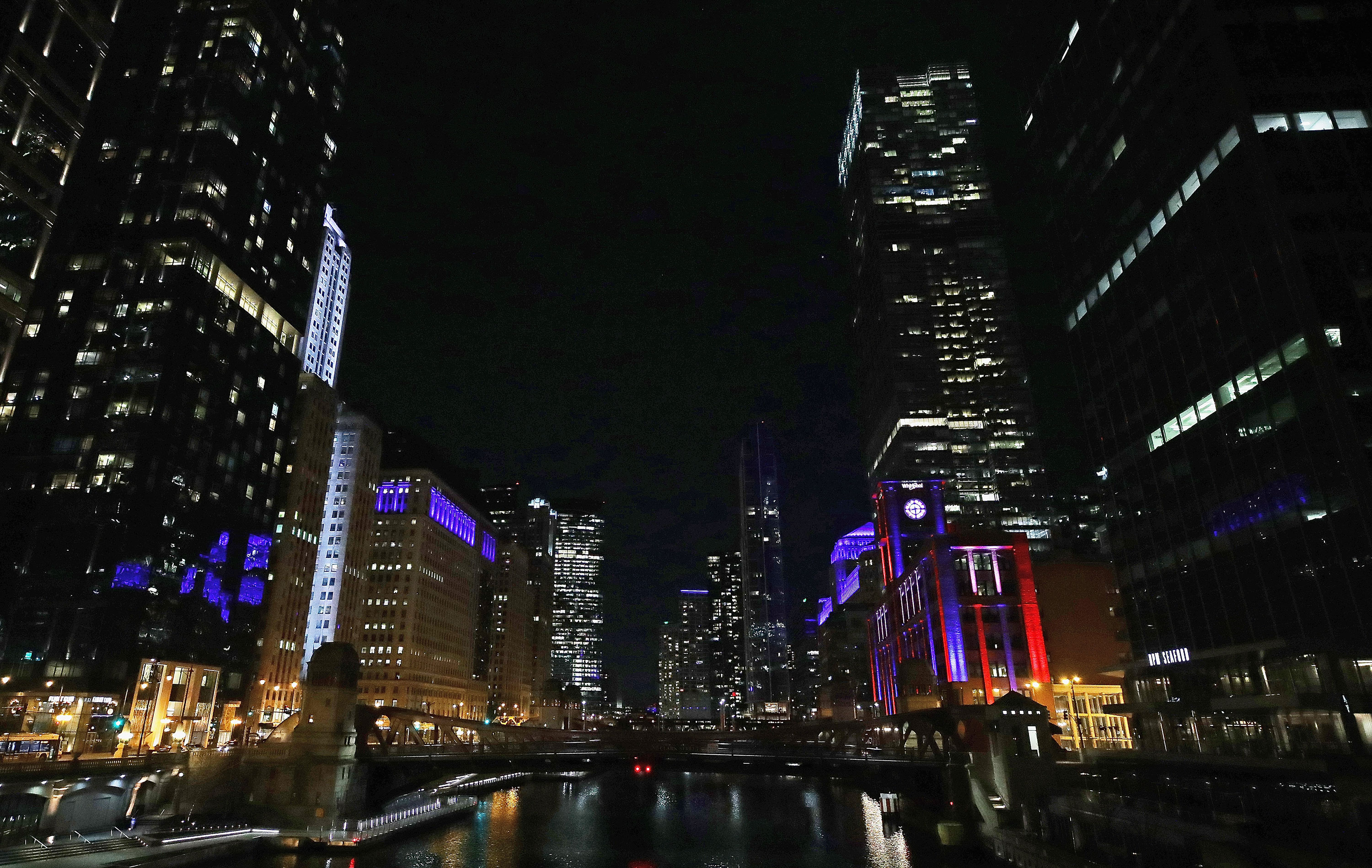 A general view looking south down the Chicago River as buildings are lit in blue to show support for health care workers and first responders on April 9.