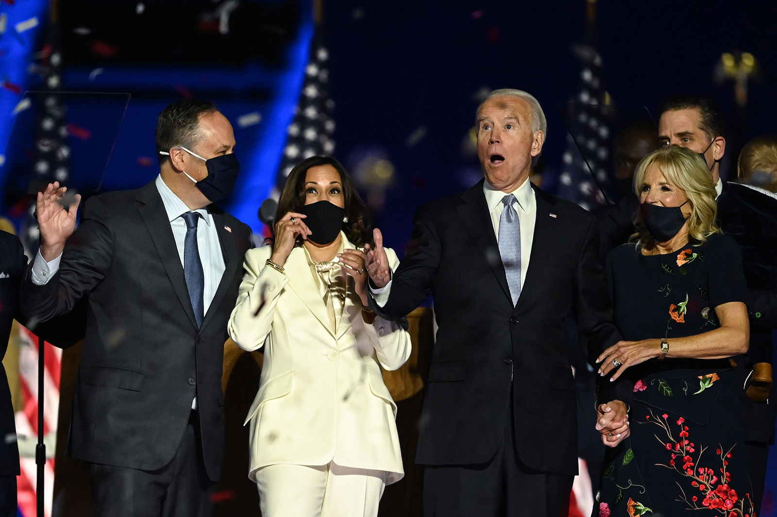 US President-elect Joe Biden and Vice President-elect Kamala Harris react as confetti falls, with Jill Biden and Douglas Emhoff, after delivering remarks in Wilmington, Delaware, on November 7, after being declared the winners of the presidential election.