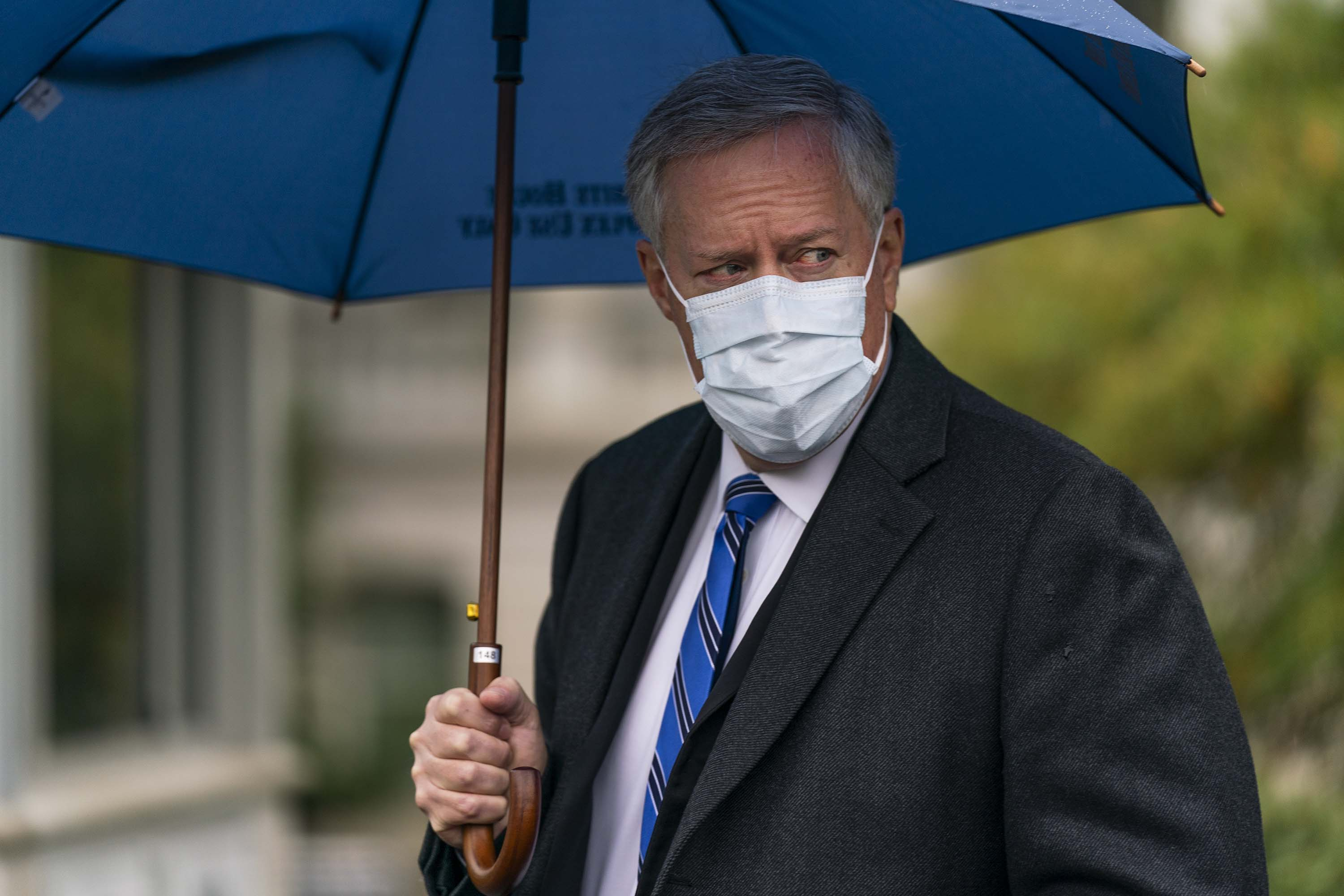 White House chief of staff Mark Meadows responds to reporters questions outside the White House on Sunday, October 25, in Washington.