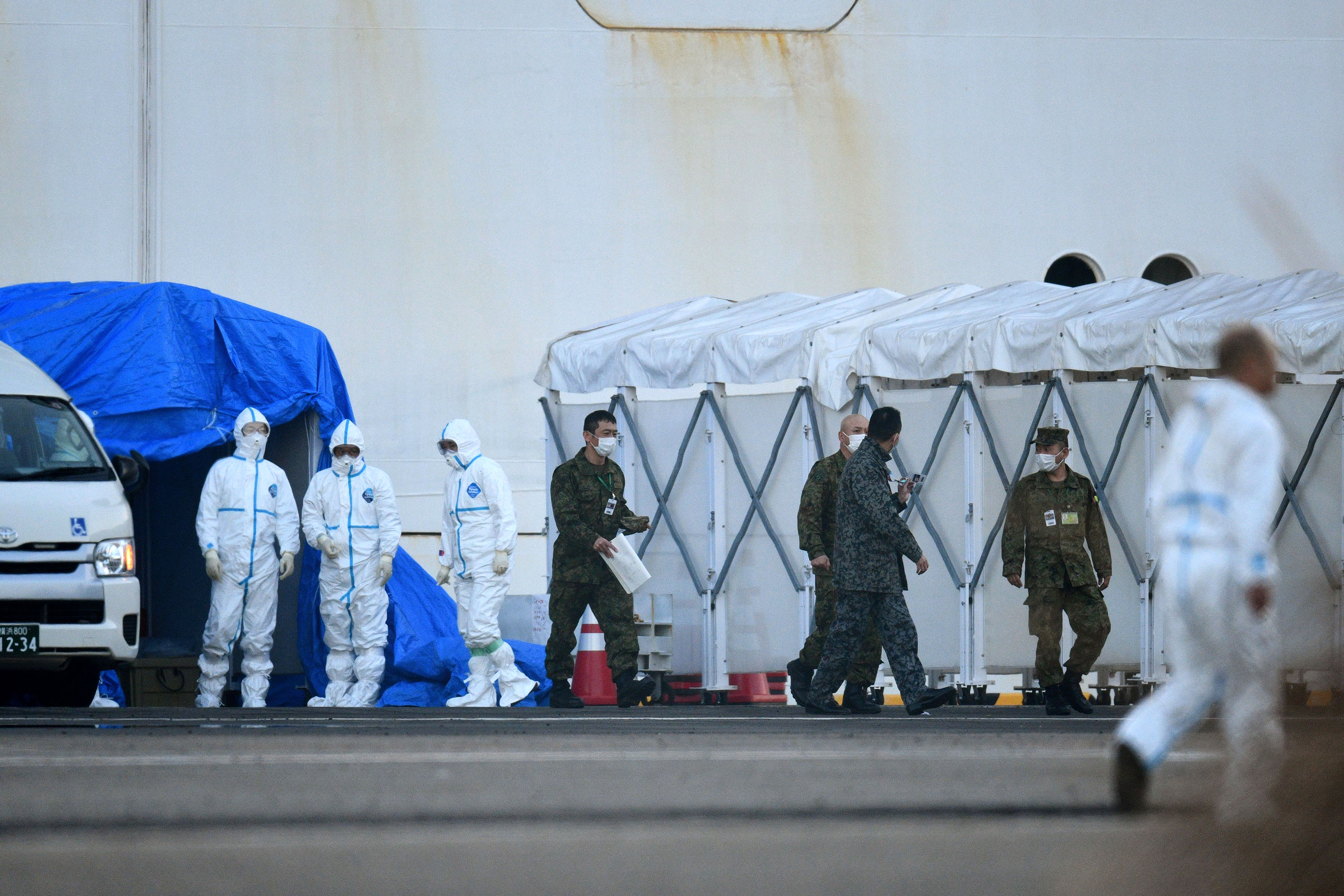 Medical staff and military personnel are seen near the quarantined Diamond Princess cruise ship on February 13.