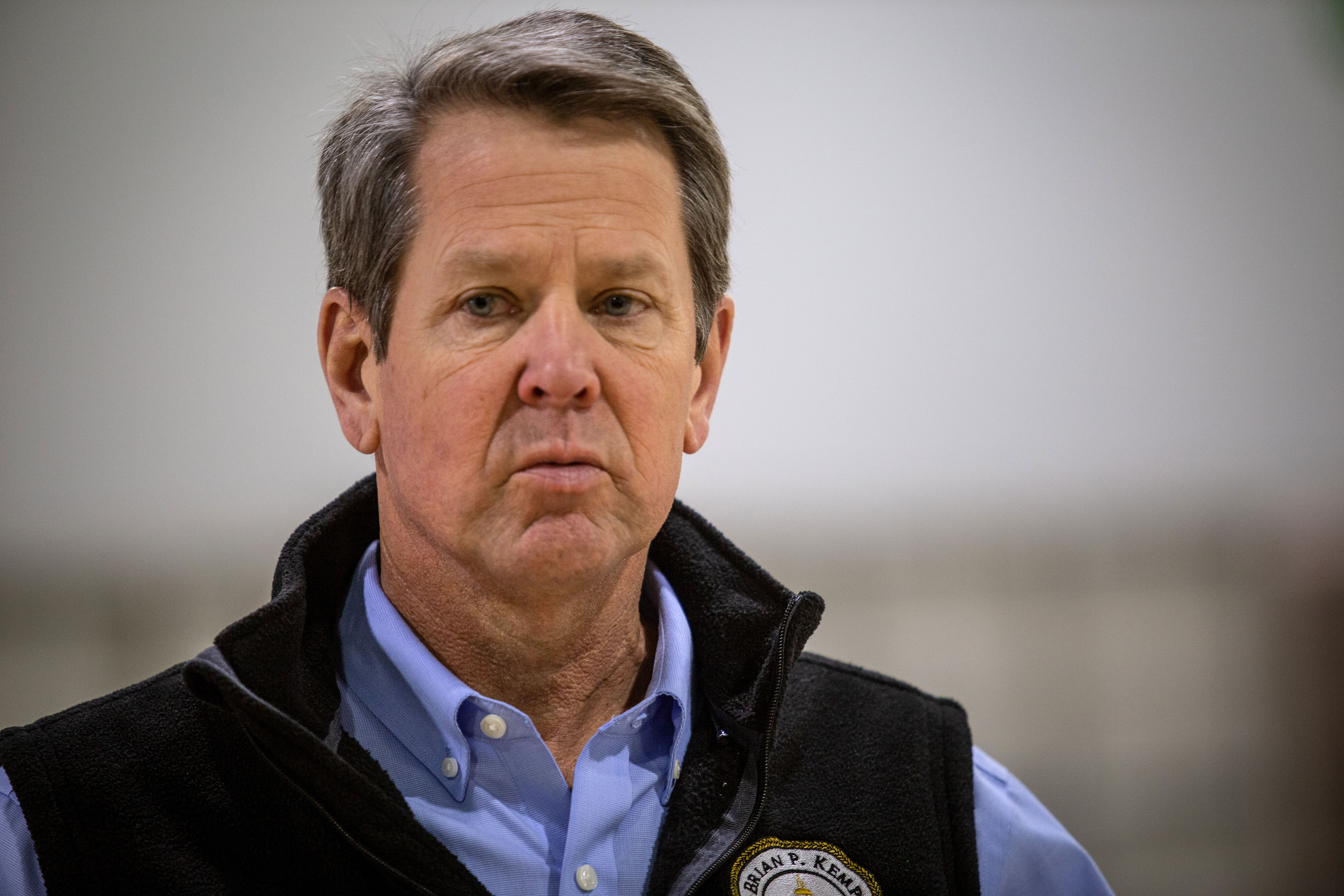 Georgia Gov. Brian Kemp listens to a question from the press during a tour of a temporary hospital at the Georgia World Congress Center in Atlanta on April 16.