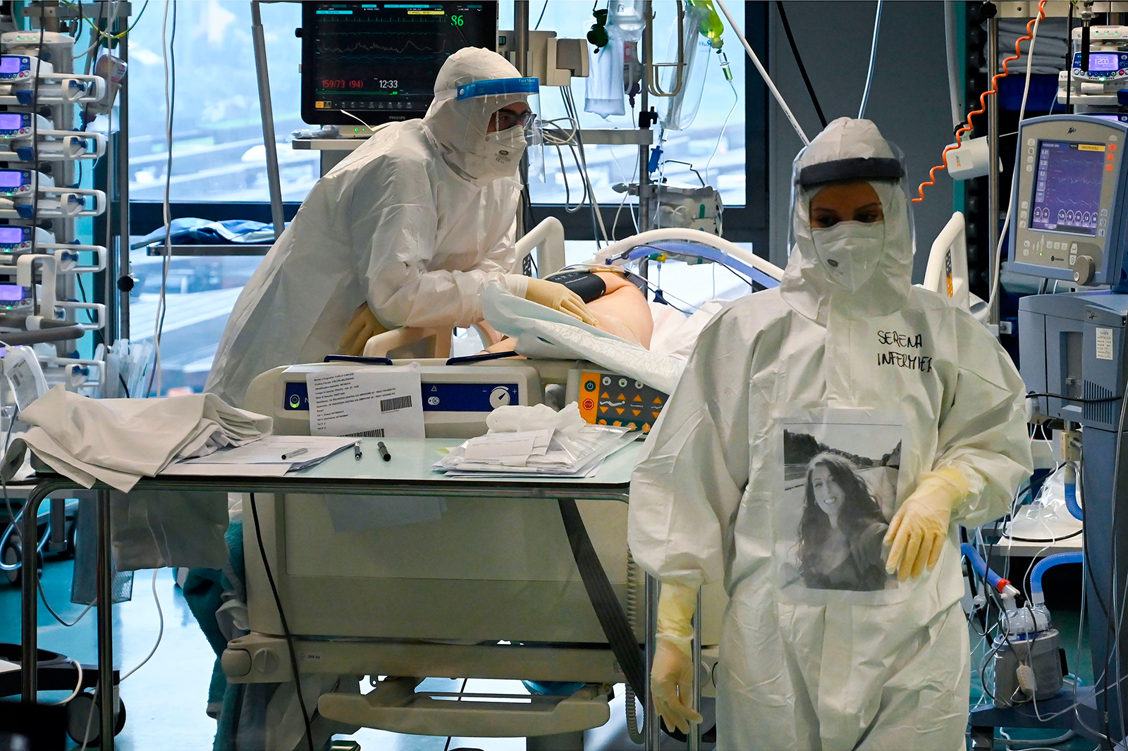Medical workers of the Covid-19 intensive care unit at the Santo Stefano hospital in Prato, near Florence, tending to a patient on December 17.