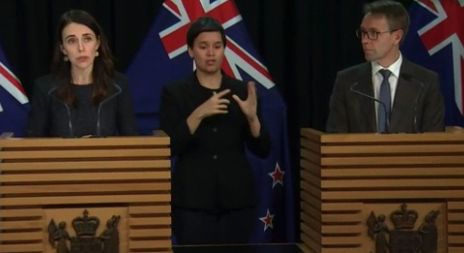 New Zealand Prime Minister Jacinda Ardern, left, and Director-General of Health Ashley Bloomfield, right, attend a news conference on August 11 in Wellington, New Zealand.