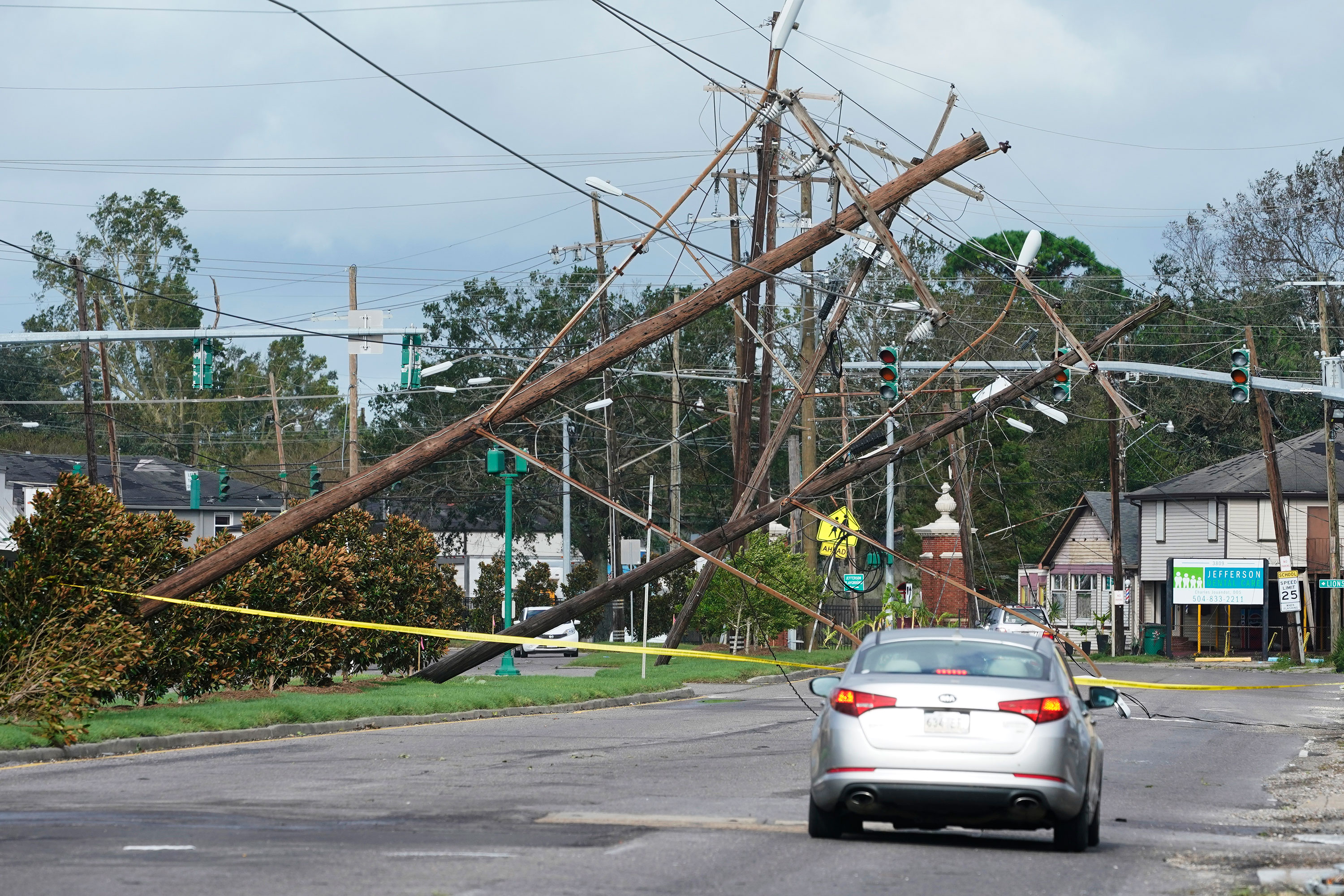 Traffic diverts around downed power lines in Metairie, Louisiana.