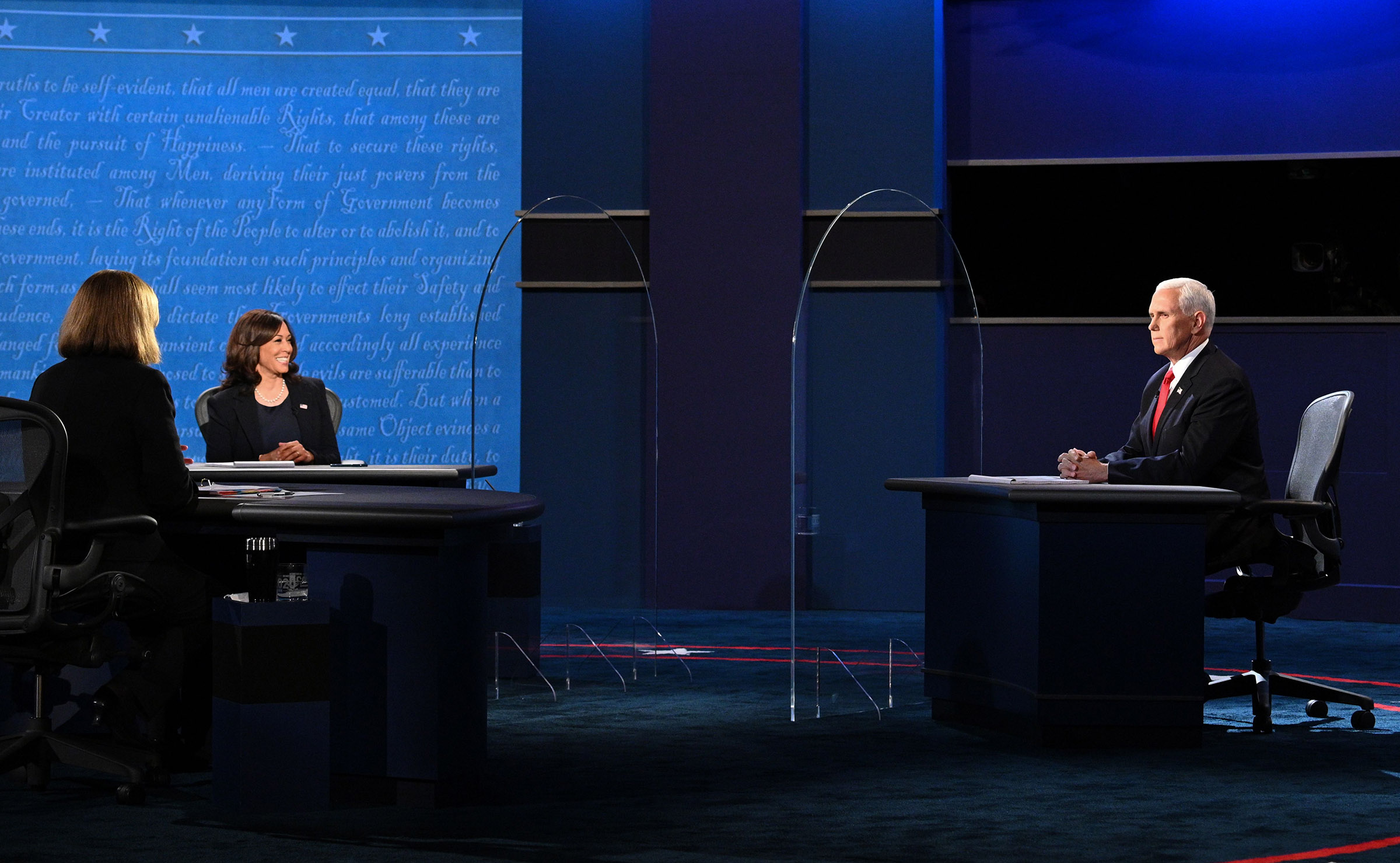 Democratic vice presidential nominee Sen. Kamala Harris and Vice President Mike Pence participate in the vice presidential debate at the University of Utah, on October 7.