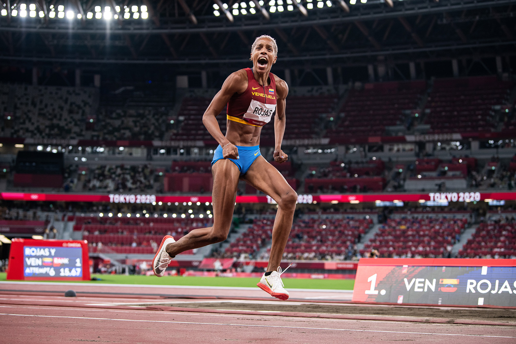 Venezuela's Yulimar Rojas celebrates aftersetting a new world record in the triple jumpon August 1.