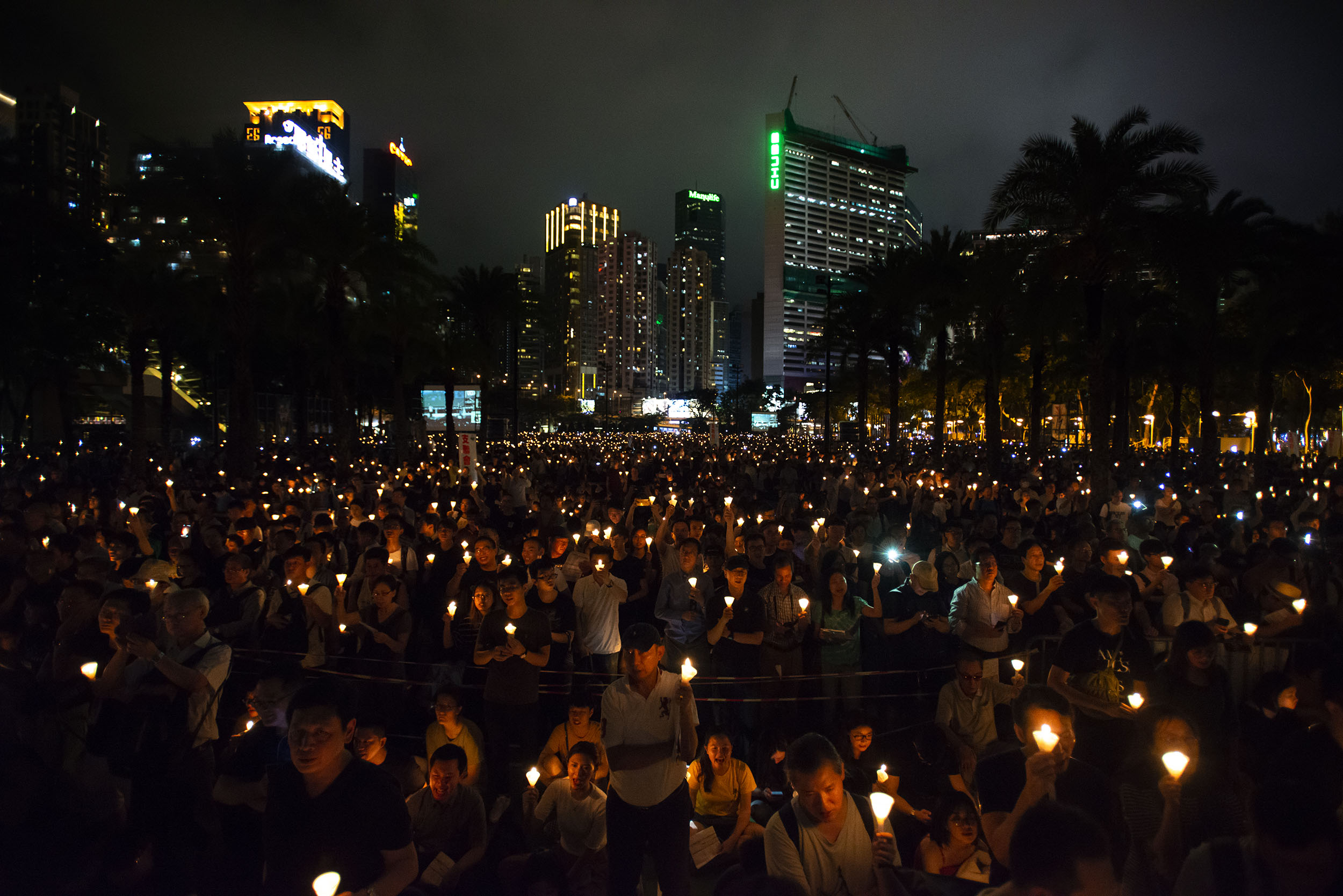 People hold up candles during a vigil in Hong Kong on June 4, 2019, marking 30 years since the massacre at Tiananmen Square in Beijing.