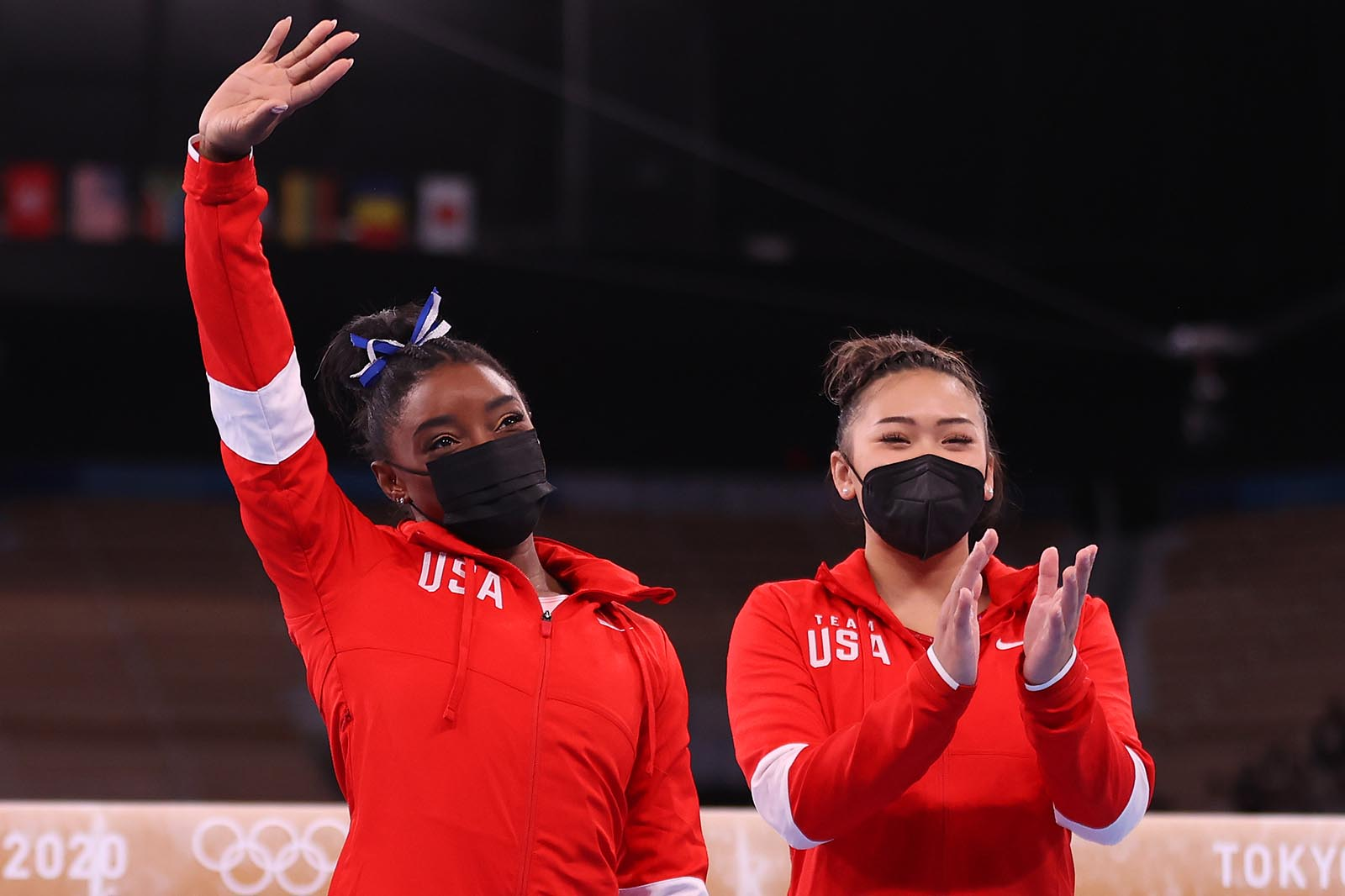 Simone Biles acknowledges the crowd, alongside teammate Sunisa Lee, prior to the women's balance beam final on August 3.