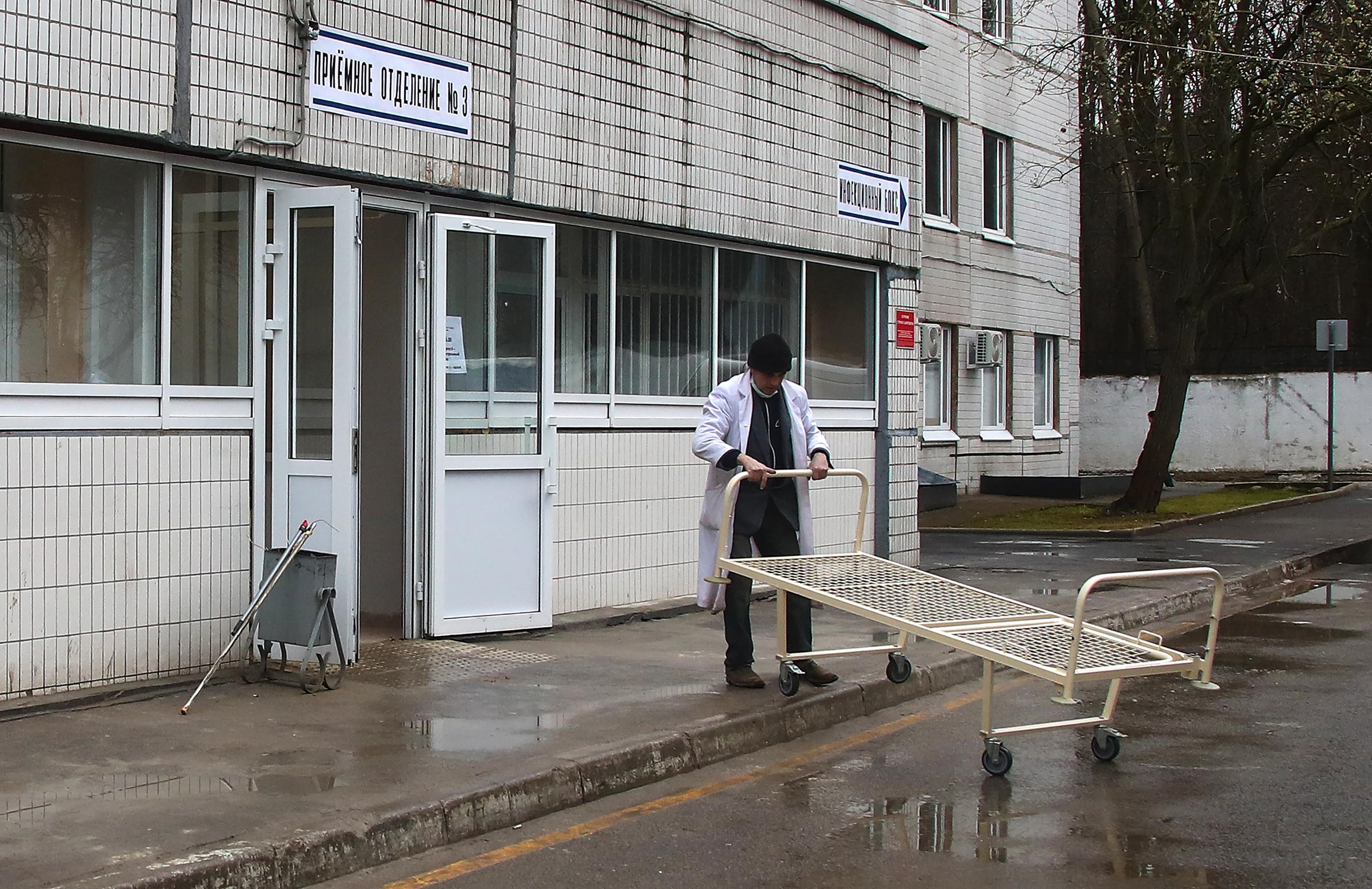 A hospital bed is moved at Spasokukotsky Municipal Clinical Hospital, which has been converted into an facility to treat coronavirus patients, in Moscow, Russia, on April 14.