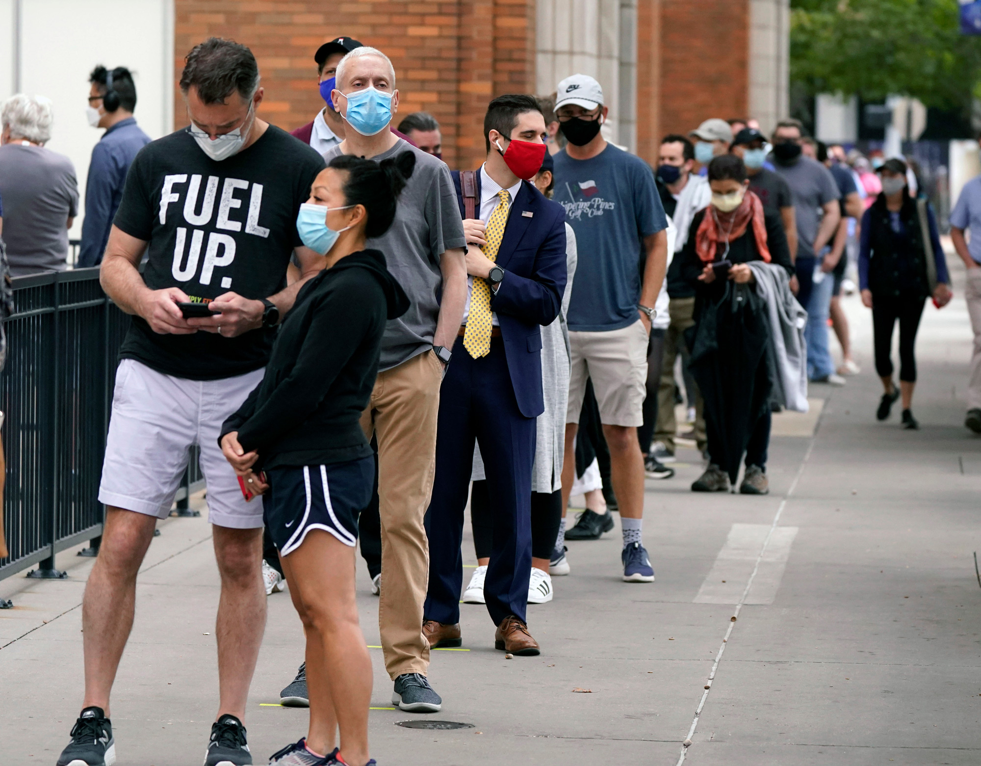 Voters wait to cast a ballot at the American Airlines Center during early voting on October 15 in Dallas.