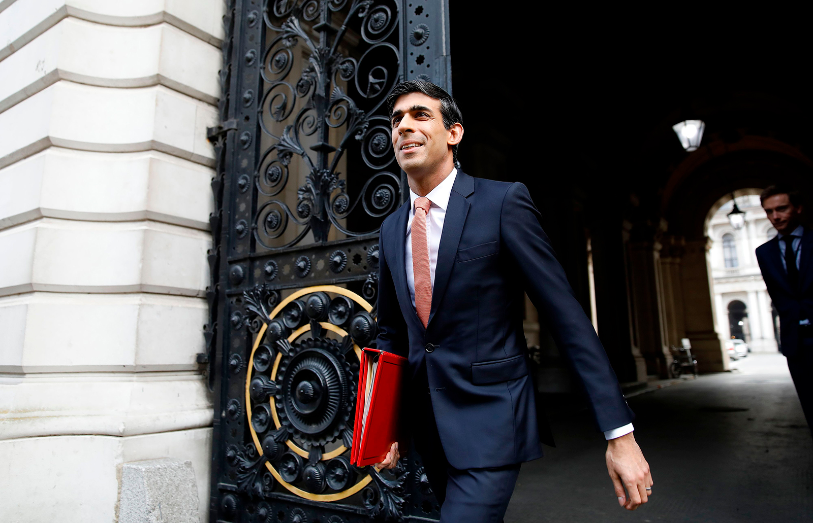 UK Chancellor Rishi Sunak walks to 10 Downing Street in central London on April 8.