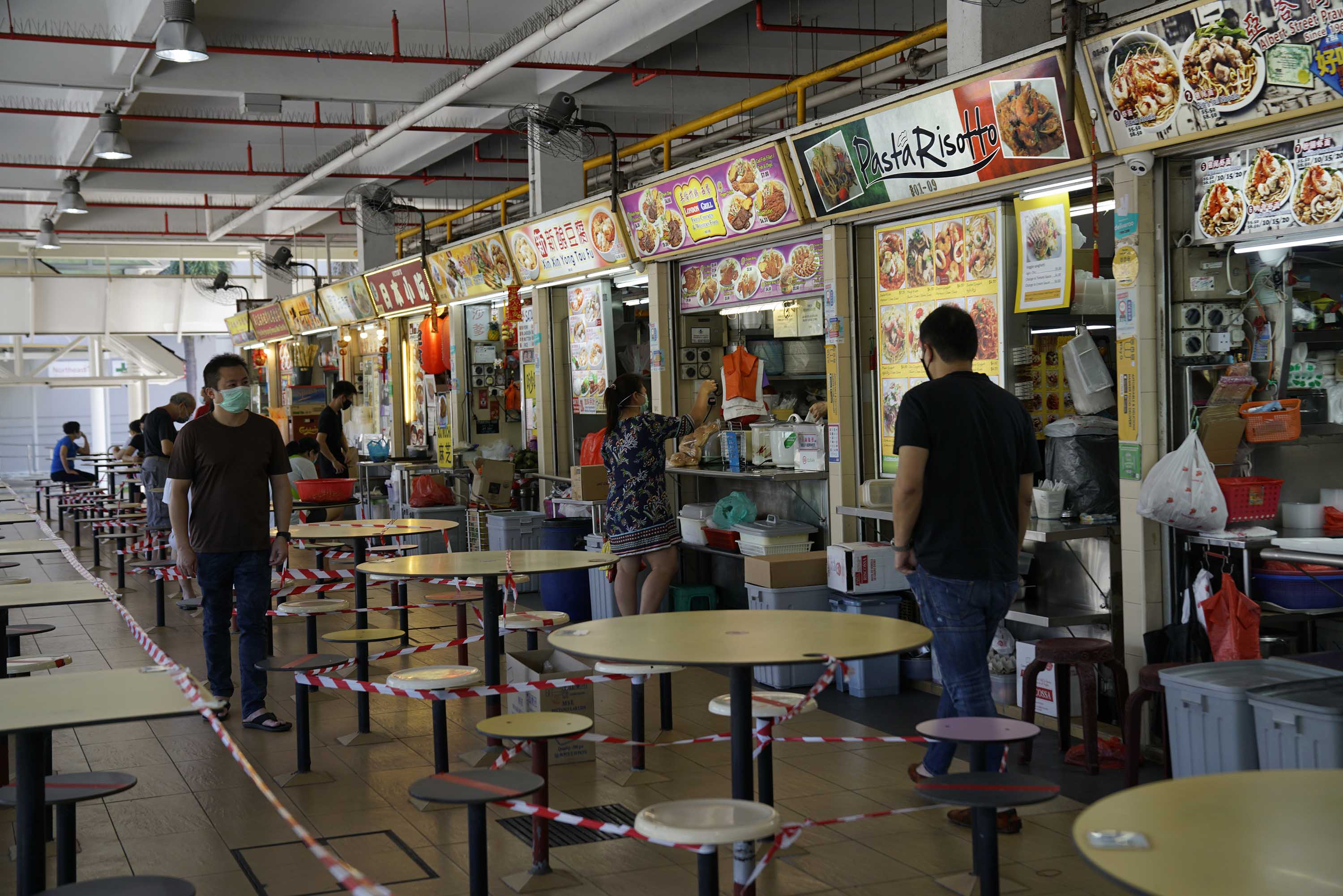 The seating area of a food court is seen taped off during a partial lockdown restrictions in Singapore on April 20.