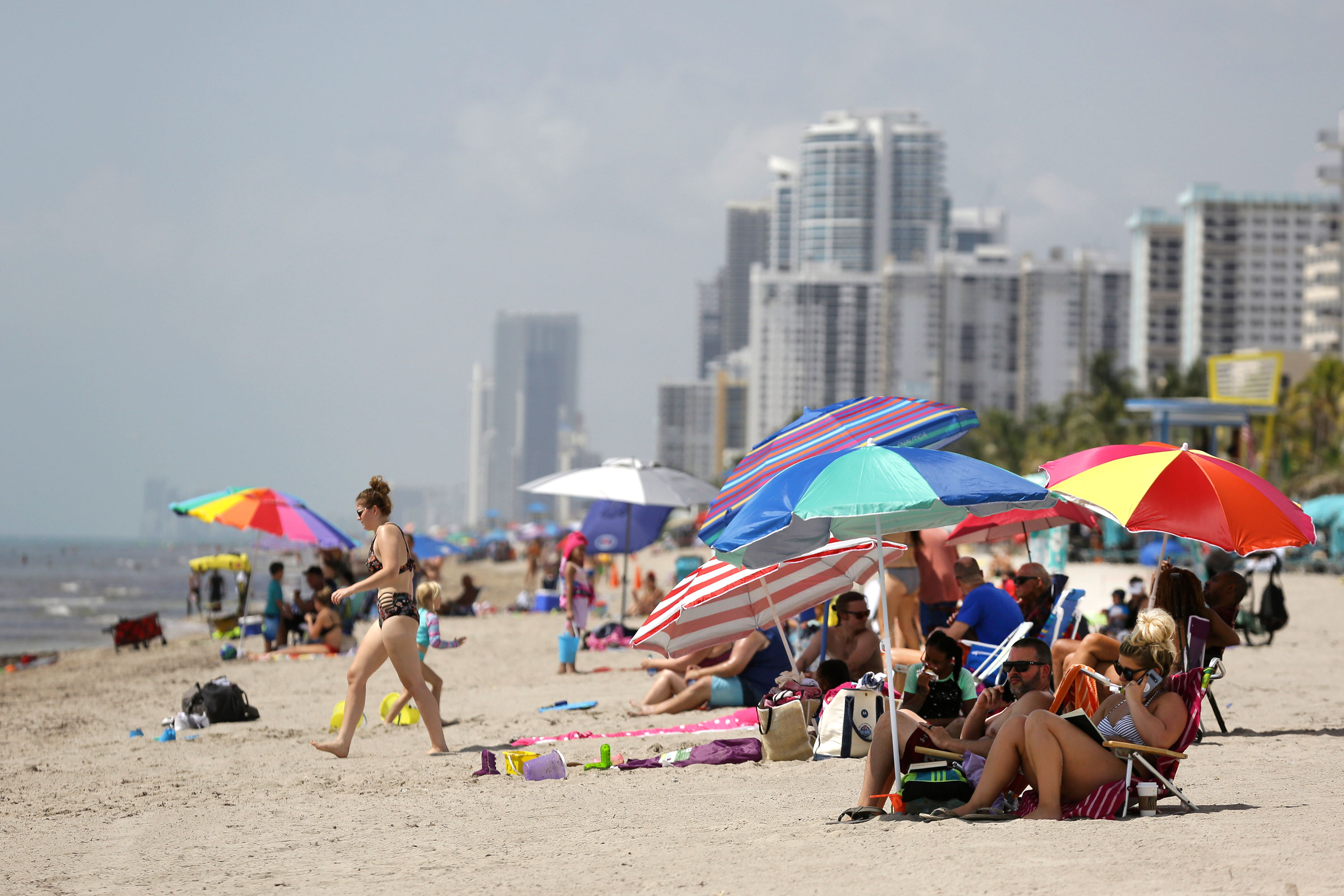 People sit on Hollywood Beach on, July 2 in Hollywood, Florida.